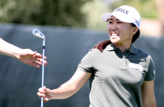 In-Kyung Kim smiles at her caddie after teeing off on the 8th tee during round two of the ANA Inspiration at Mission Hills Country Club in Rancho Mirage on Friday, April 5, 2019.