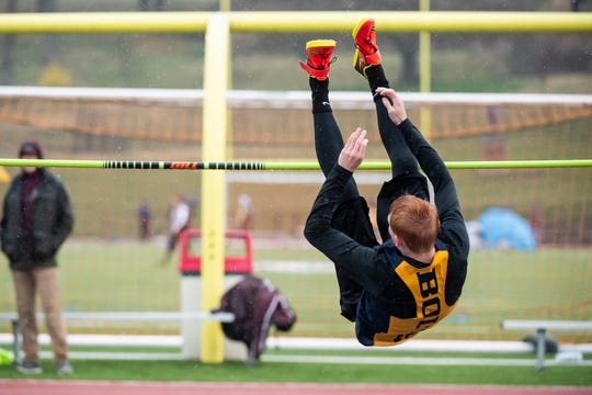 Littlestown's Dan Gazmen clears the bar in the high jump during the Adams County Track and Field Classic in Gettysburg on Friday, April 5, 2019. Gazmen took first place with 5 feet, 10 inches.