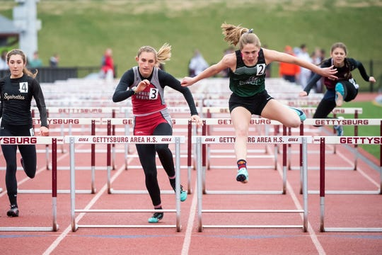 Fairfield's Zoe Logue (2) leaps over a hurdle in the 100 meter hurdles during the Adams County Track and Field Classic in Gettysburg on Friday, April 5, 2019. Logue won with a time of 16:57 seconds.