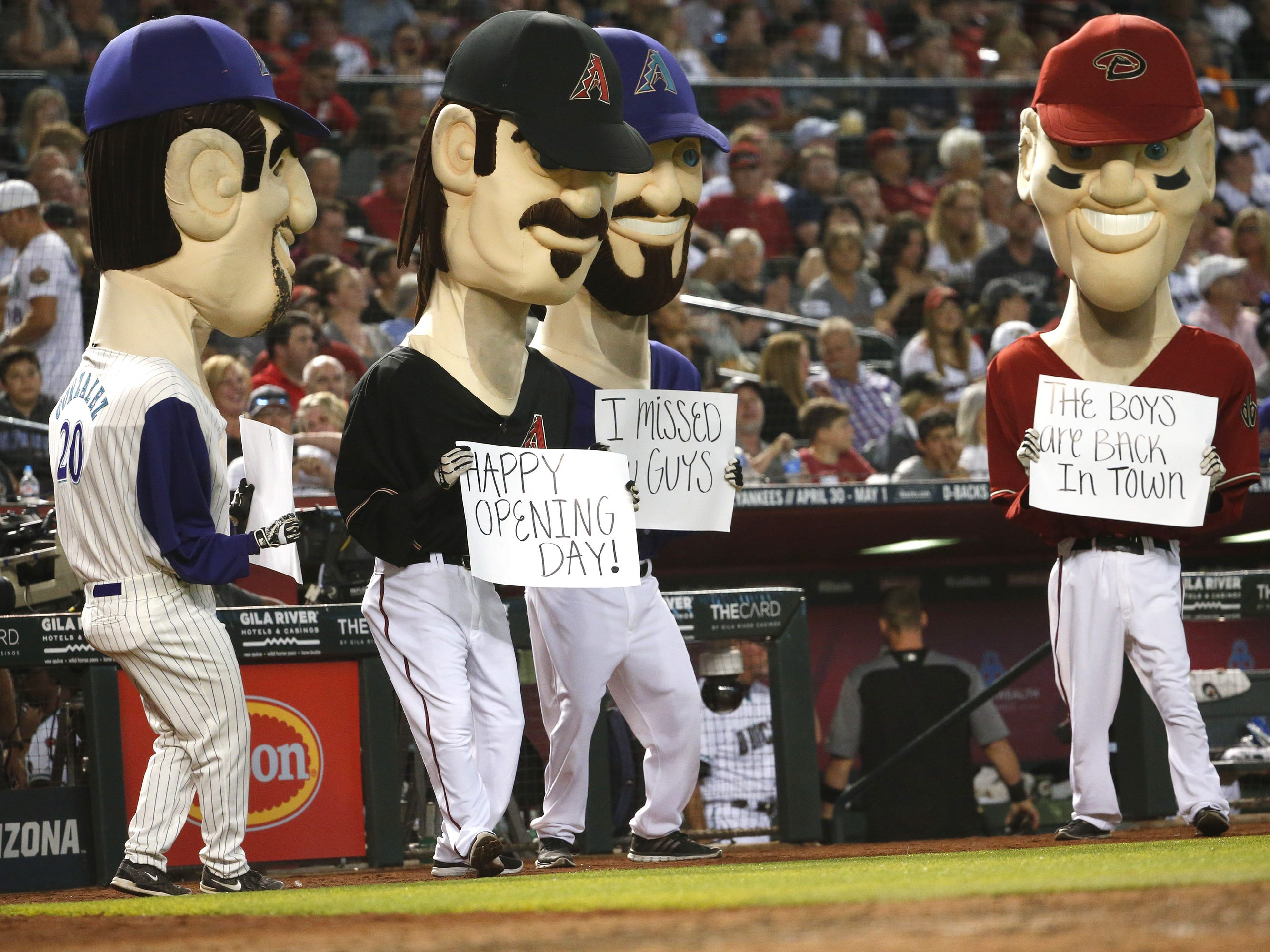 Arizona Diamondbacks legends welcome backs fans during Opening Day at Chase Field in Phoenix on April 5.