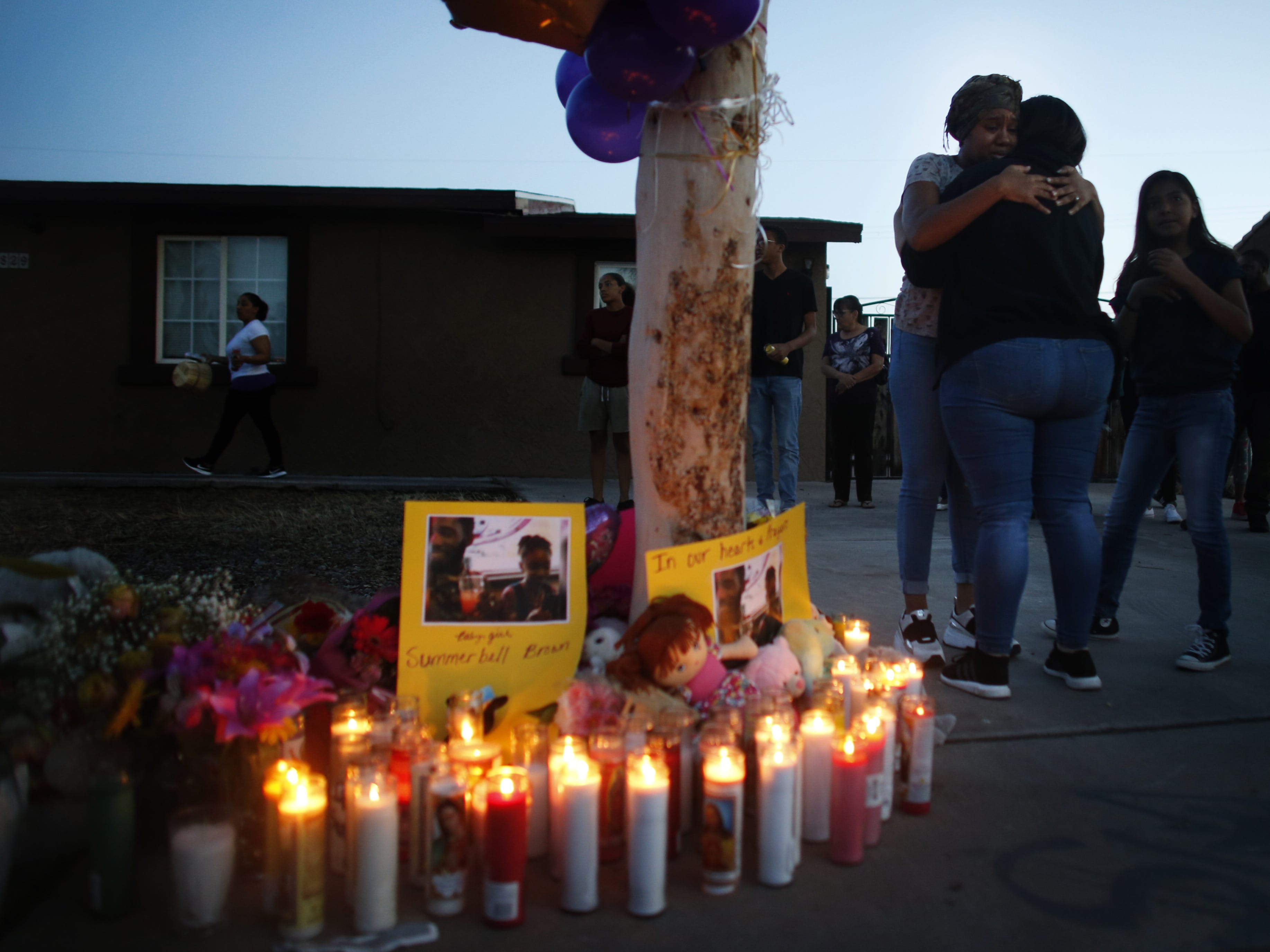 Summer's mother Taniesha Brown hugs people who came to support their family at a vigil on April 5, 2019, for Summer Bell Brown outside her home where she was shot and killed in Phoenix.