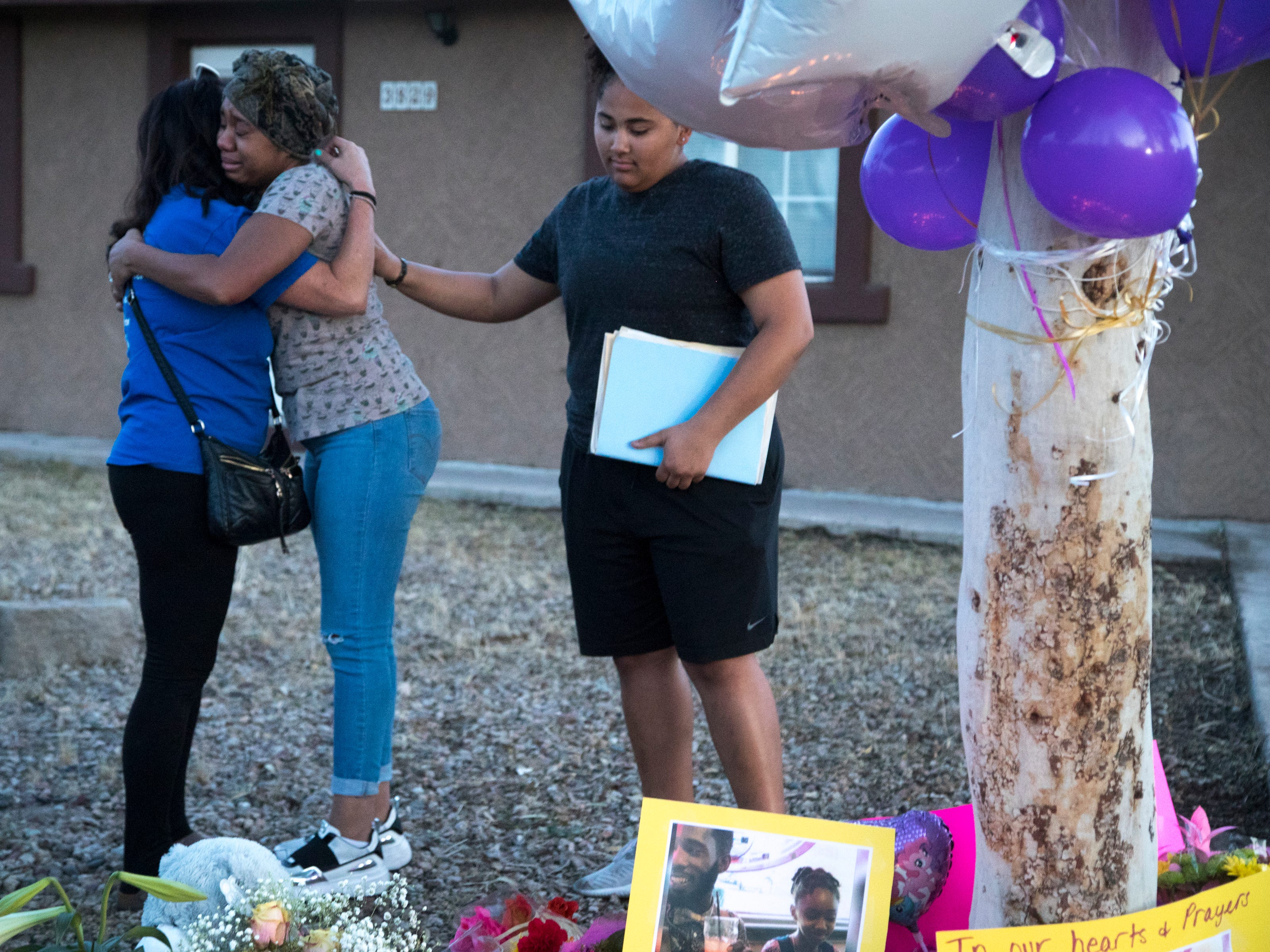 Taniesha Brown (center, Summer's mom) is hugged by Rebecka Johnson (left, Summer's 5th grade teacher) during a vigil for Summer Bell Brown on April 5, 2019. At right is Destaine Clark (family friend).