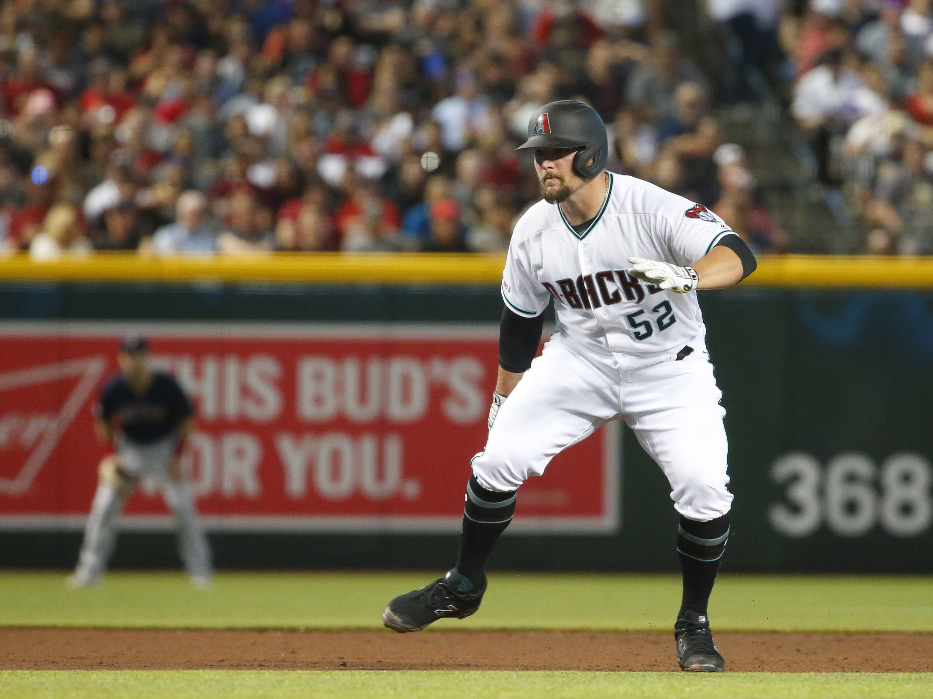 Arizona Diamondbacks starting pitcher Zack Godley (52) leads off on second base during Opening Day against the Boston Red Sox at Chase Field in Phoenix on April 5.