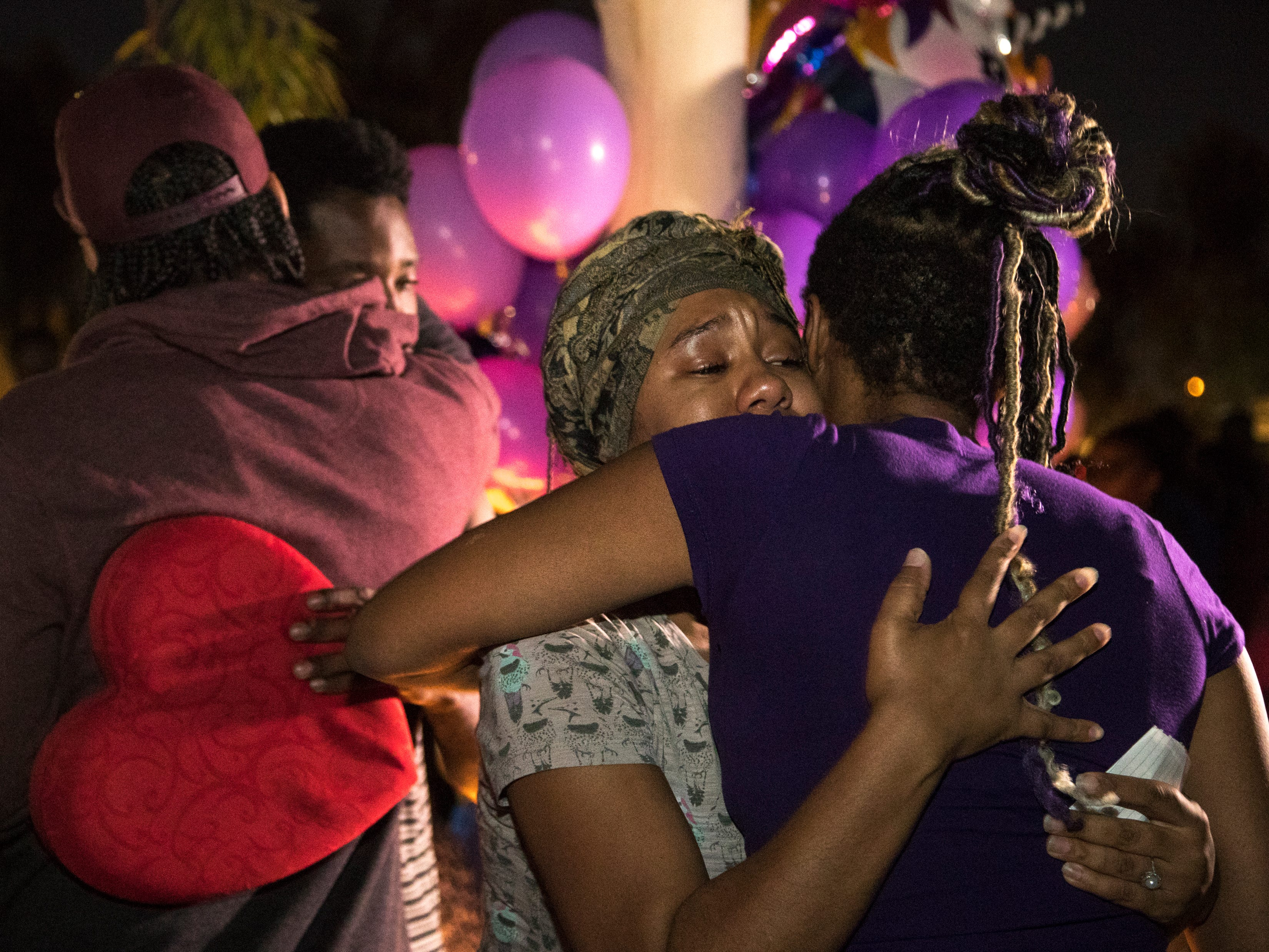 Taniesha Brown (right, center Summer's mom) and Dharquintium Brown (left center, Summer's dad) are comforted during a vigil for Summer Bell Brown on April 5, 2019. Summer was shot in the driveway of her home and later died from her injuries in a suspected road-rage incident.