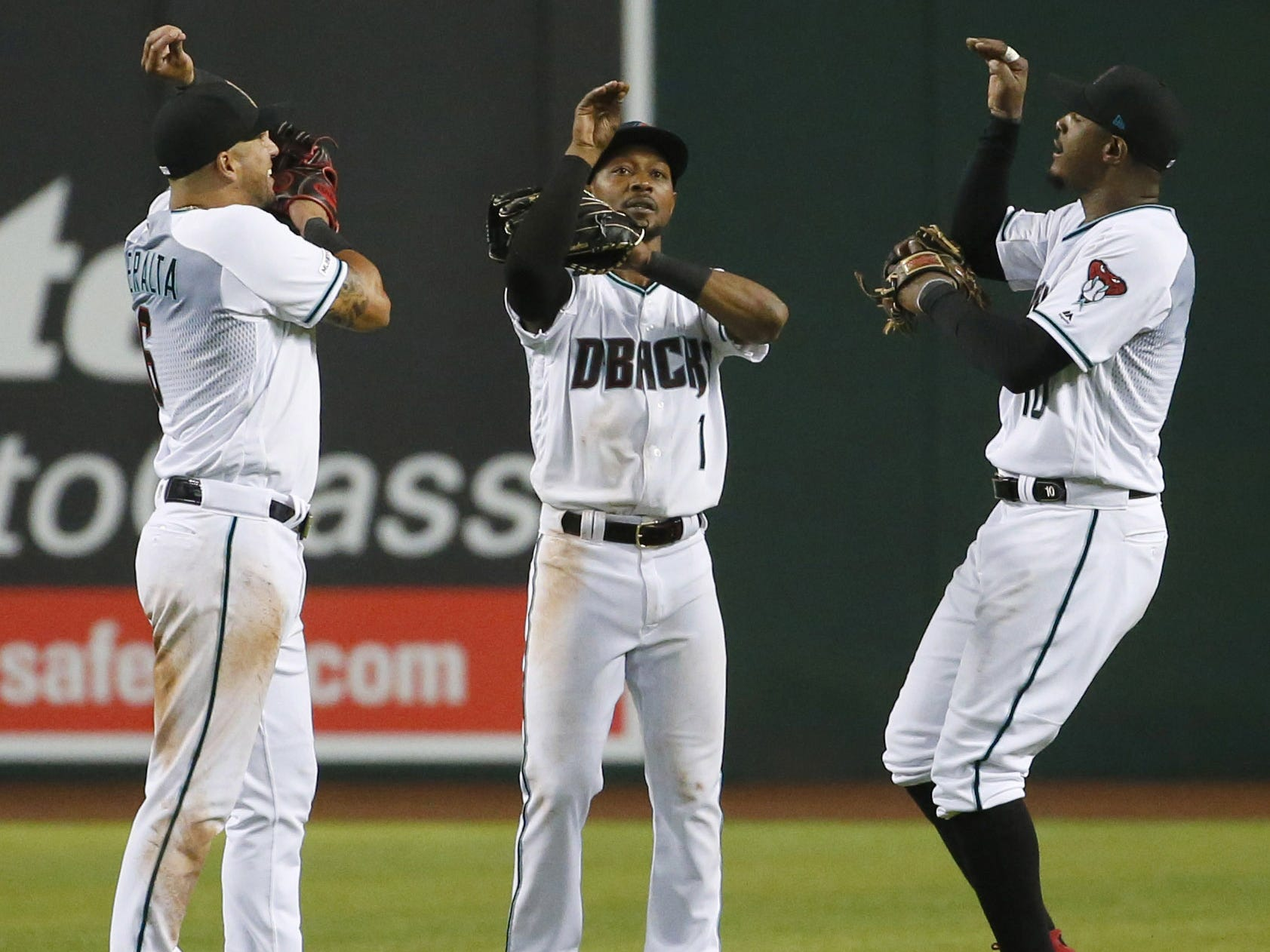 Arizona Diamondbacks right fielder David Peralta (6),  center fielder Jarrod Dyson (1)and  right fielder Adam Jones (10) celebrate winning Opening Day game 15-8 against Boston Red Sox at Chase Field in Phoenix on April 5.