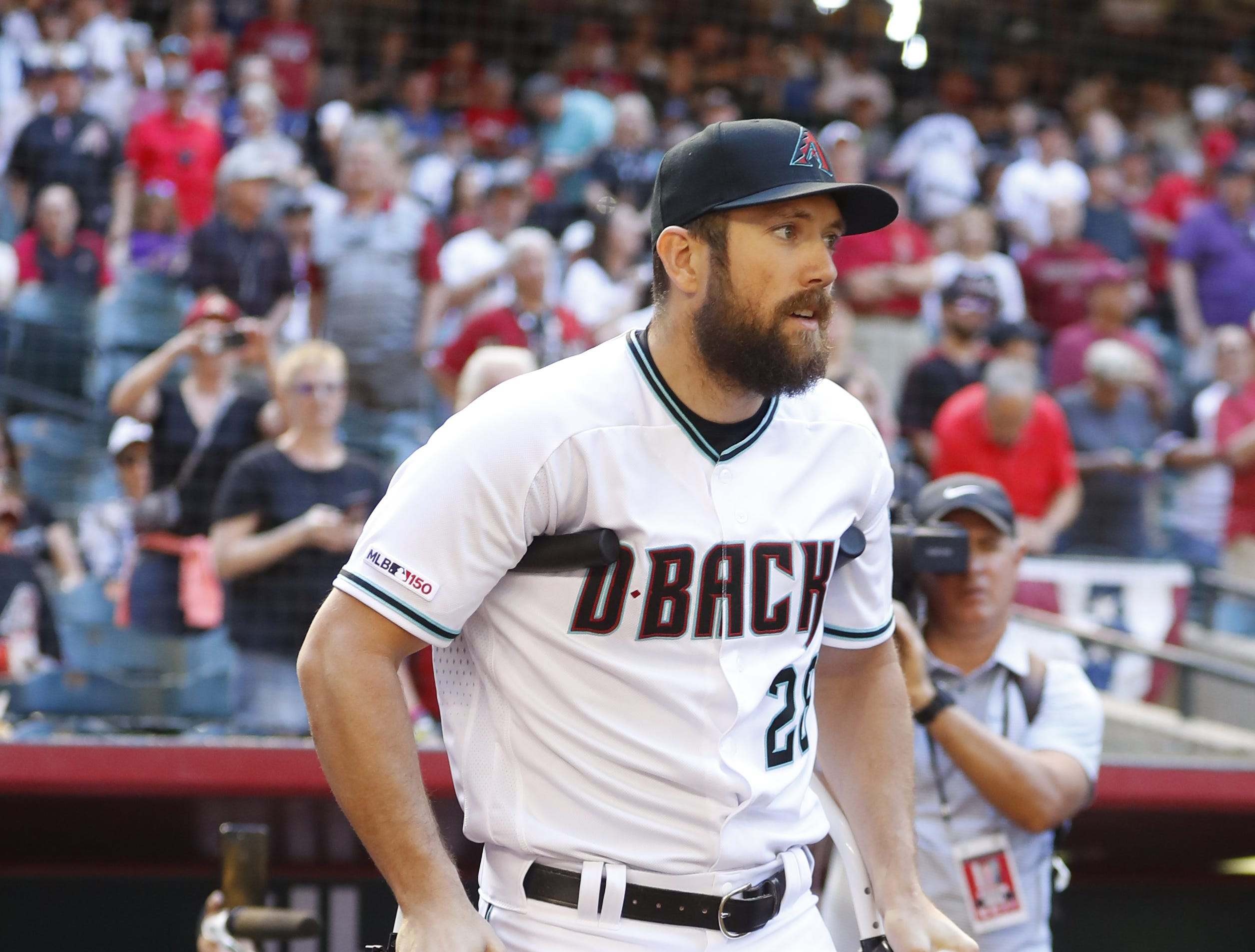 Diamondbacks Steven Souza Jr. uses crutches to make his way out of the dugout before the Diamondbacks vs. Red Sox game at Chase Field on the Opening Day for the Diamondbacks in Phoenix, Ariz. on April 5, 2019.
