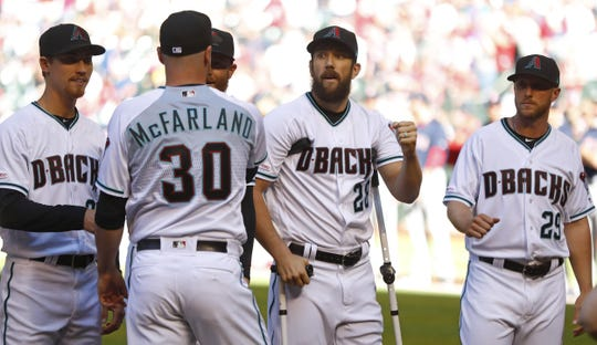 T.J. McFarland (30) fist bumps Steven Souza Jr. (28) before the Diamondbacks took on the Red Sox on Opening Day on April 5 at Chase Field.