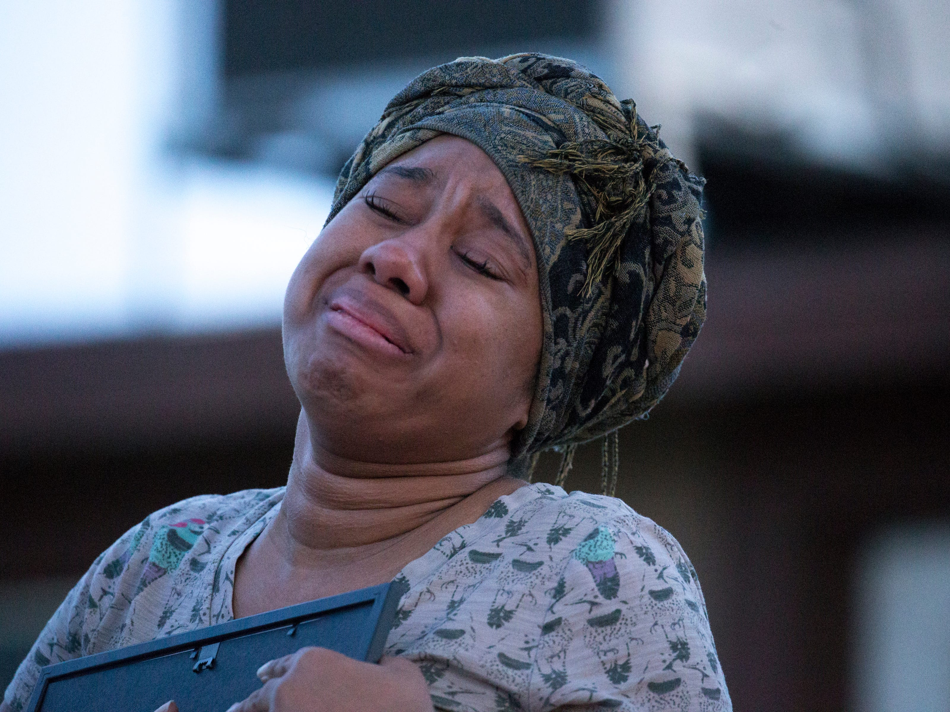 Taniesha Brown (right, Summer's mom) is overcome with emotion after Rebecka Johnson (Summer's 5th grade teacher) gave her Summer's last art assignment during a vigil for Summer Bell Brown on April 5, 2019. Summer was shot in the driveway of her home and later died from her injuries in a suspected road-rage incident.