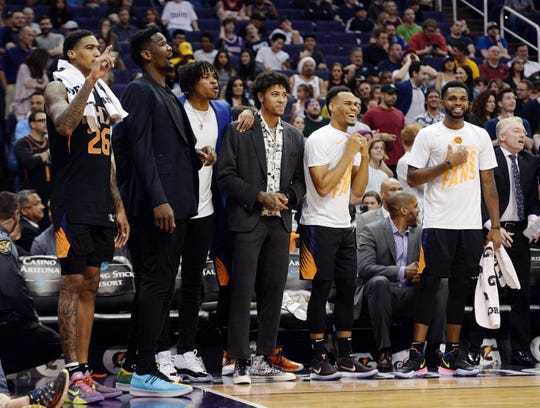 Apr 5, 2019; Phoenix, AZ, USA; The Phoenix Suns bench reacts against the New Orleans Pelicans during the overtime session at Talking Stick Resort Arena. Mandatory Credit: Joe Camporeale-USA TODAY Sports