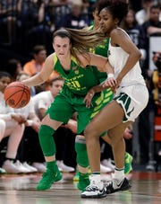 Oregon guard Sabrina Ionescu (20) dribbles around Baylor guard DiDi Richards during the second half of a Final Four semifinal of the NCAA women's college basketball tournament Friday, April 5, 2019, in Tampa, Fla. (AP Photo/Chris O'Meara)