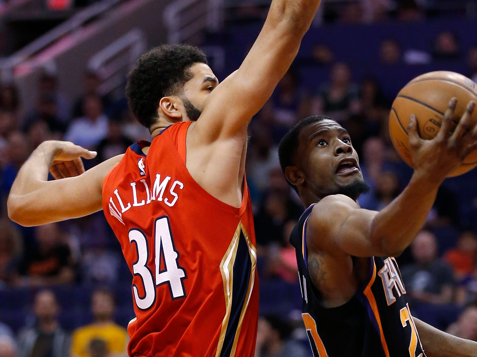 Phoenix Suns forward Josh Jackson drives past New Orleans Pelicans guard Kenrich Williams (34) during the second half of an NBA basketball game Friday, April 5, 2019, in Phoenix. The Suns defeated the Pelicans 133-126 in overtime. (AP Photo/Rick Scuteri)