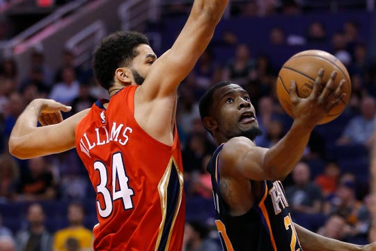 Phoenix Suns forward Josh Jackson drives past New Orleans Pelicans guard Kenrich Williams during a game in April in Phoenix.