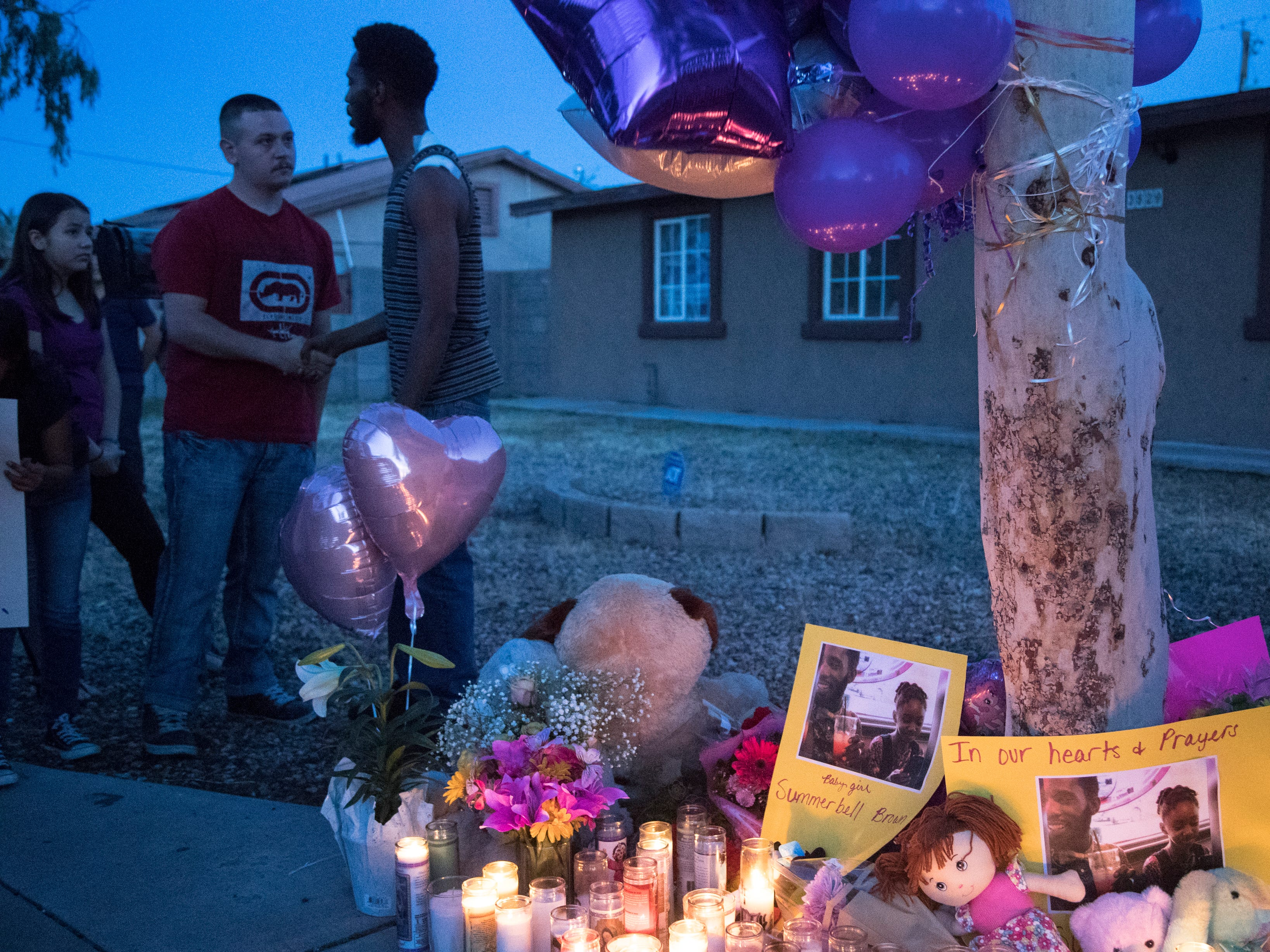 Dharquintium Brown (right, Summer's dad) is greeted by Michael Brewster (family friend) during a vigil for Summer Bell Brown on April 5, 2019.