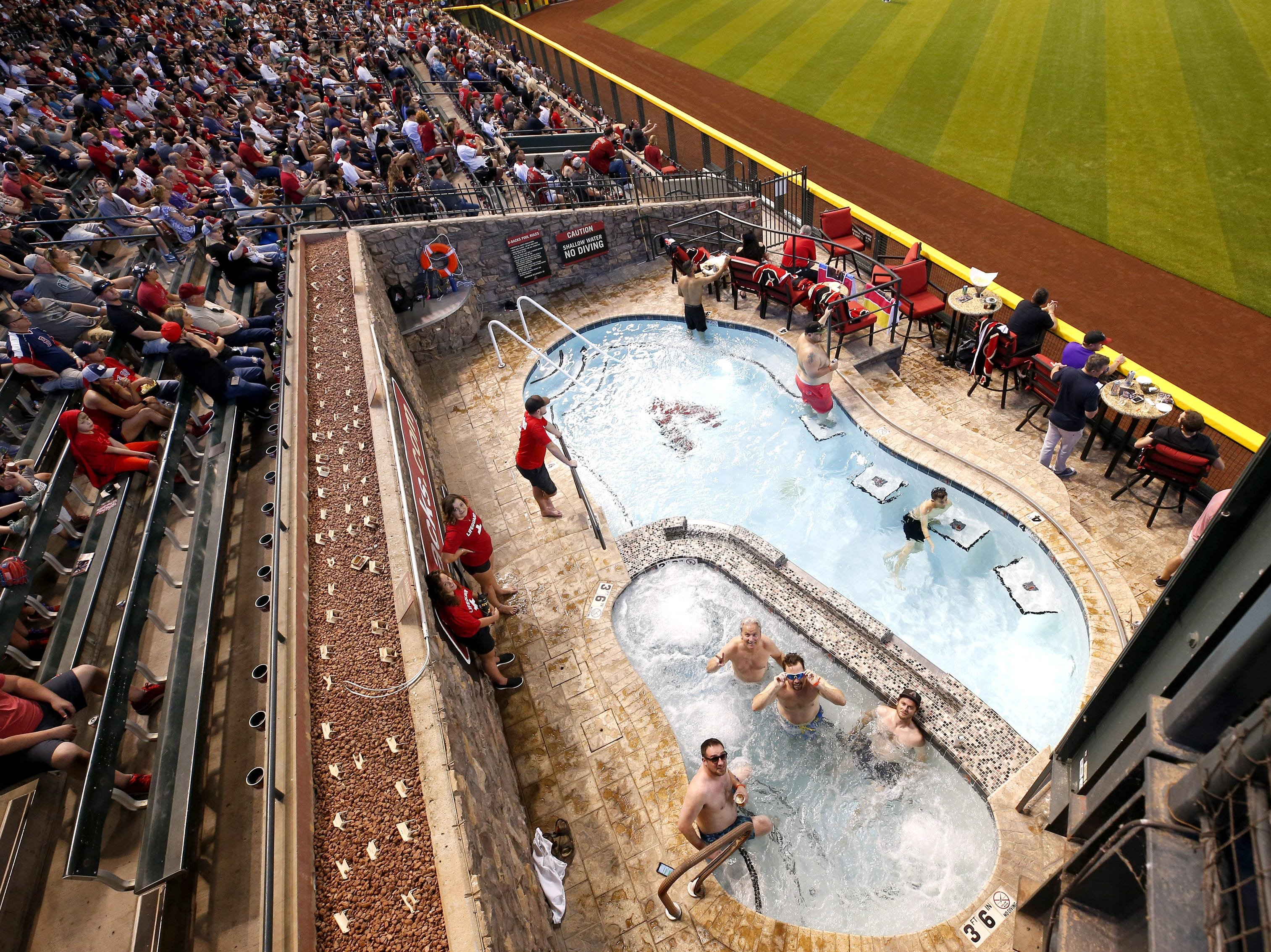Baseball fans enjoy the pool during Opening Day at Chase Field in Phoenix on April 5.