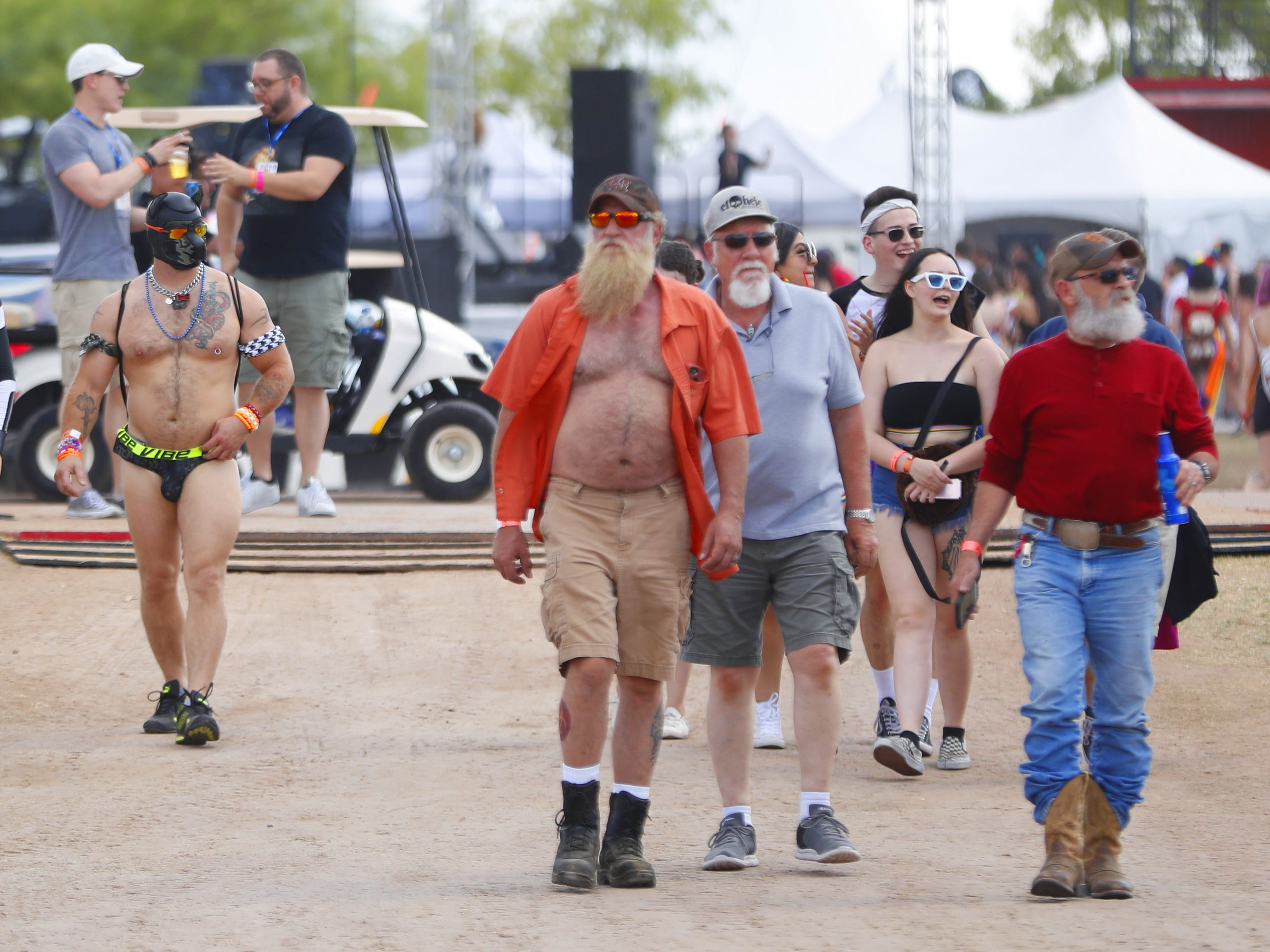 People make their way into the festivities during Phoenix Pride at Steele Indian School Park on April 6, 2019.