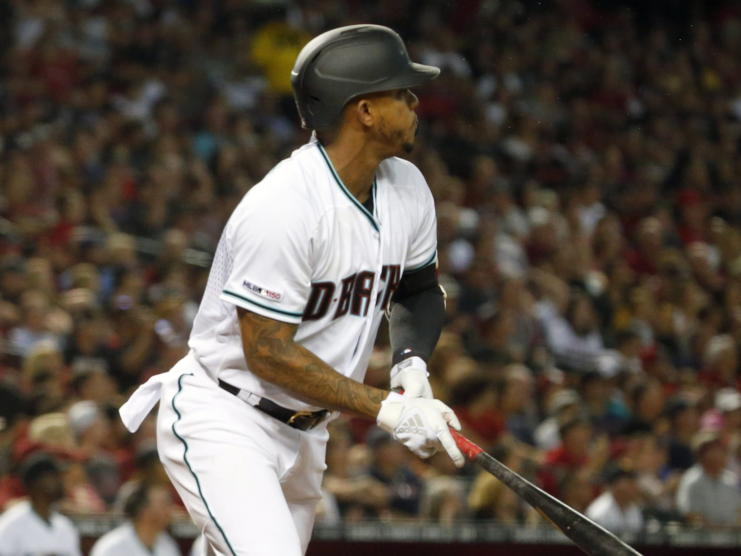 Arizona Diamondbacks shortstop Ketel Marte's (4) watches his grand slam ball in the sixth inning of a Opening Day game  against Boston Red Sox at Chase Field in Phoenix on April 5.