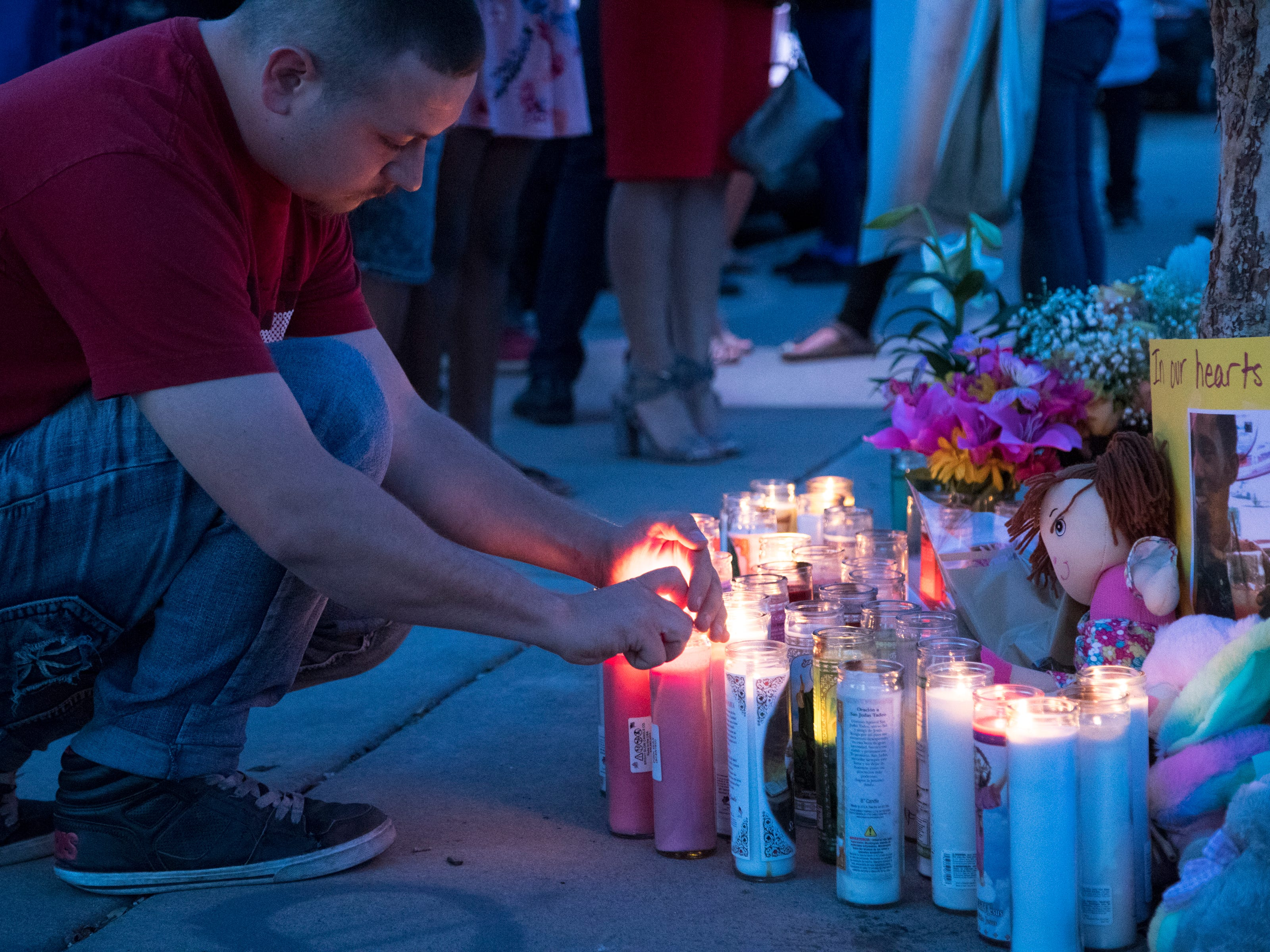 Michael Brewster (family friend) lights a candle during a vigil for Summer Bell Brown on April 5, 2019.