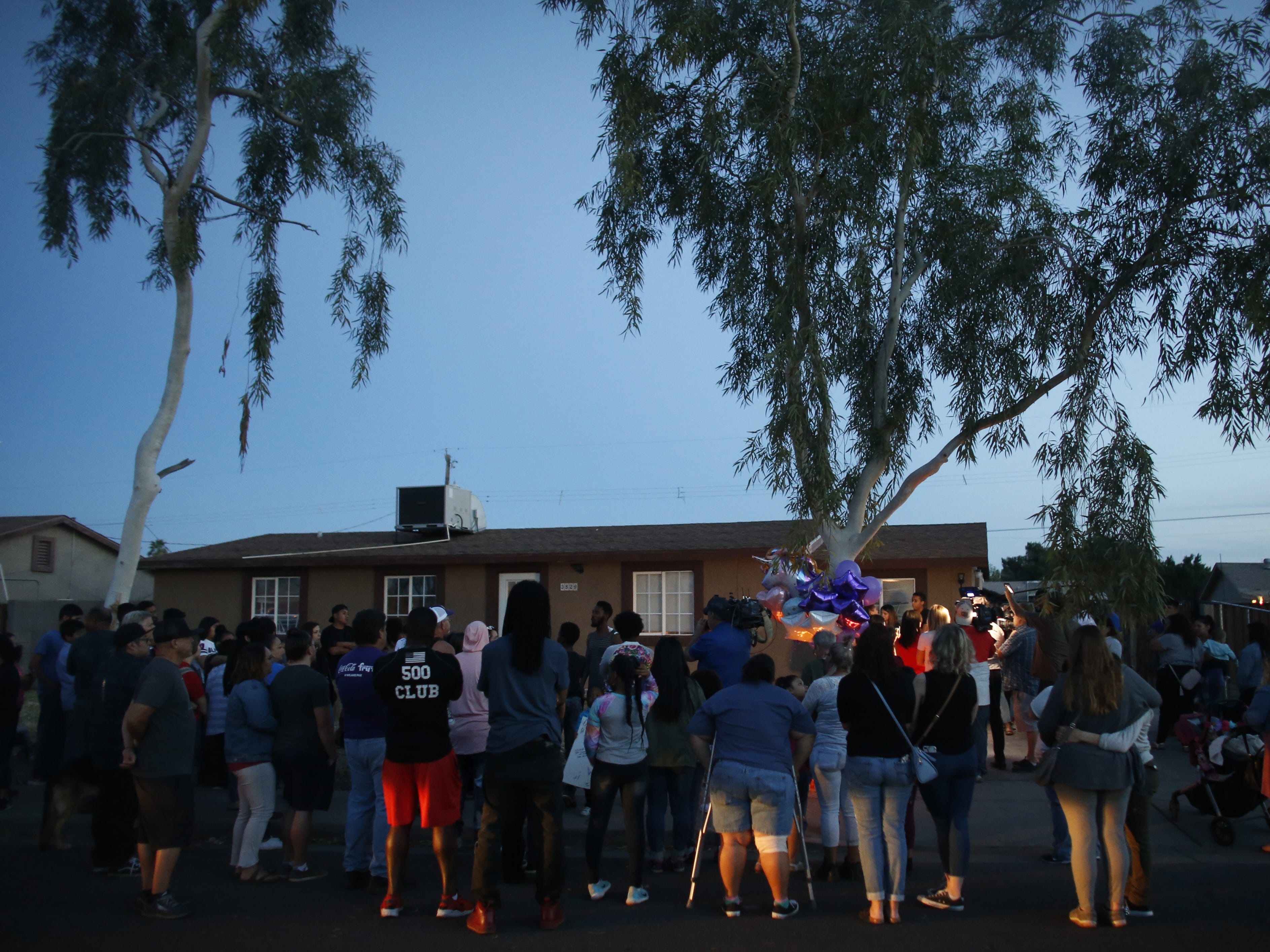 Supporters arrive as the sun sets at a vigil for Summer Bell Brown on April 5, 2019, outside her home where she was shot and killed in Phoenix. Brown was 10 years old.