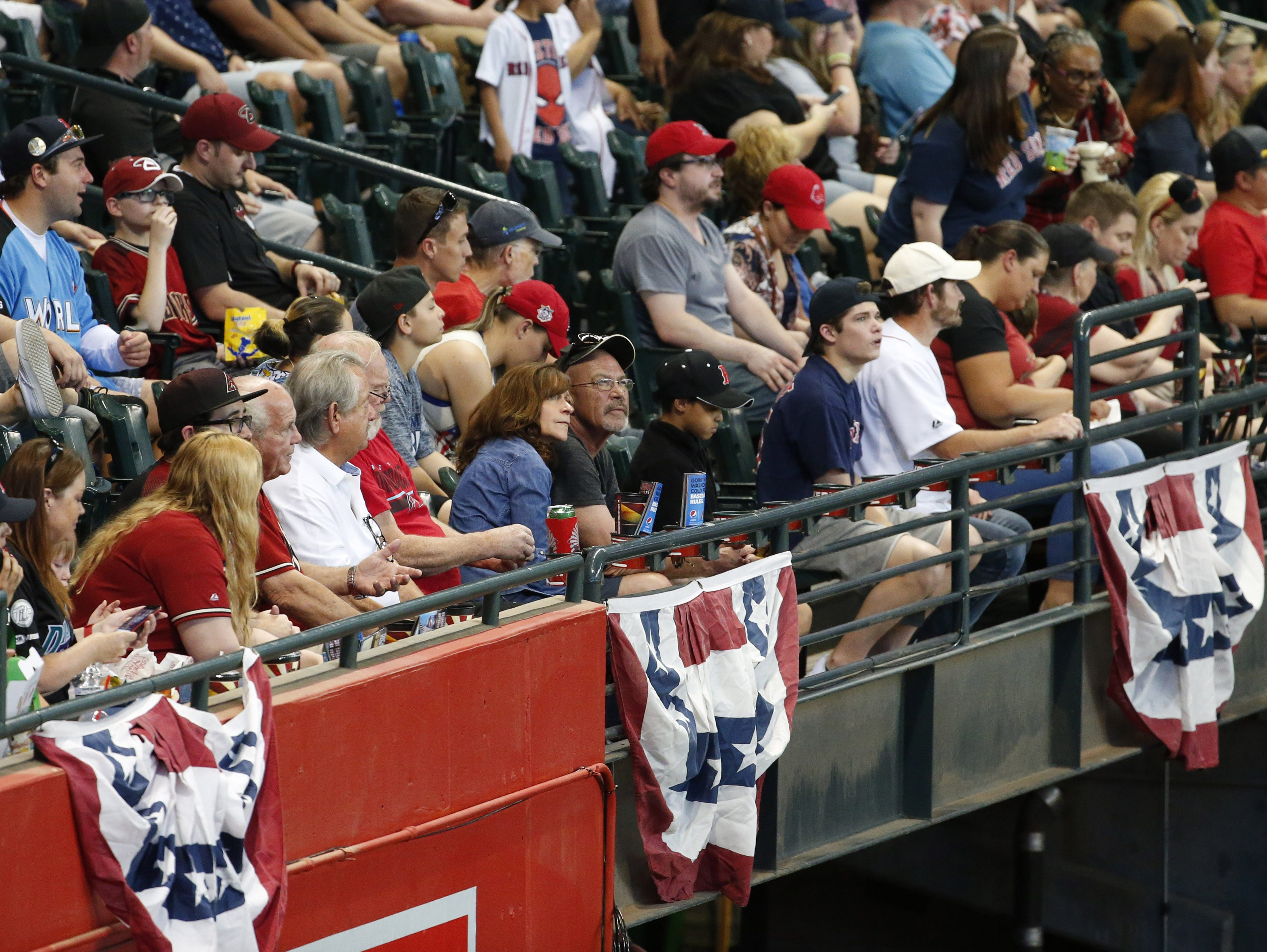 Baseball fans attendOpening Day at Chase Field in Phoenix on April 5.