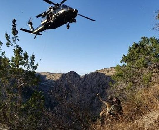 A U.S. Customs and Border Protection helicopter crew rescued a border agent who fell 15 feet and suffered injuries to his head and extremities during a drug bust Thursday west of Nogales.
