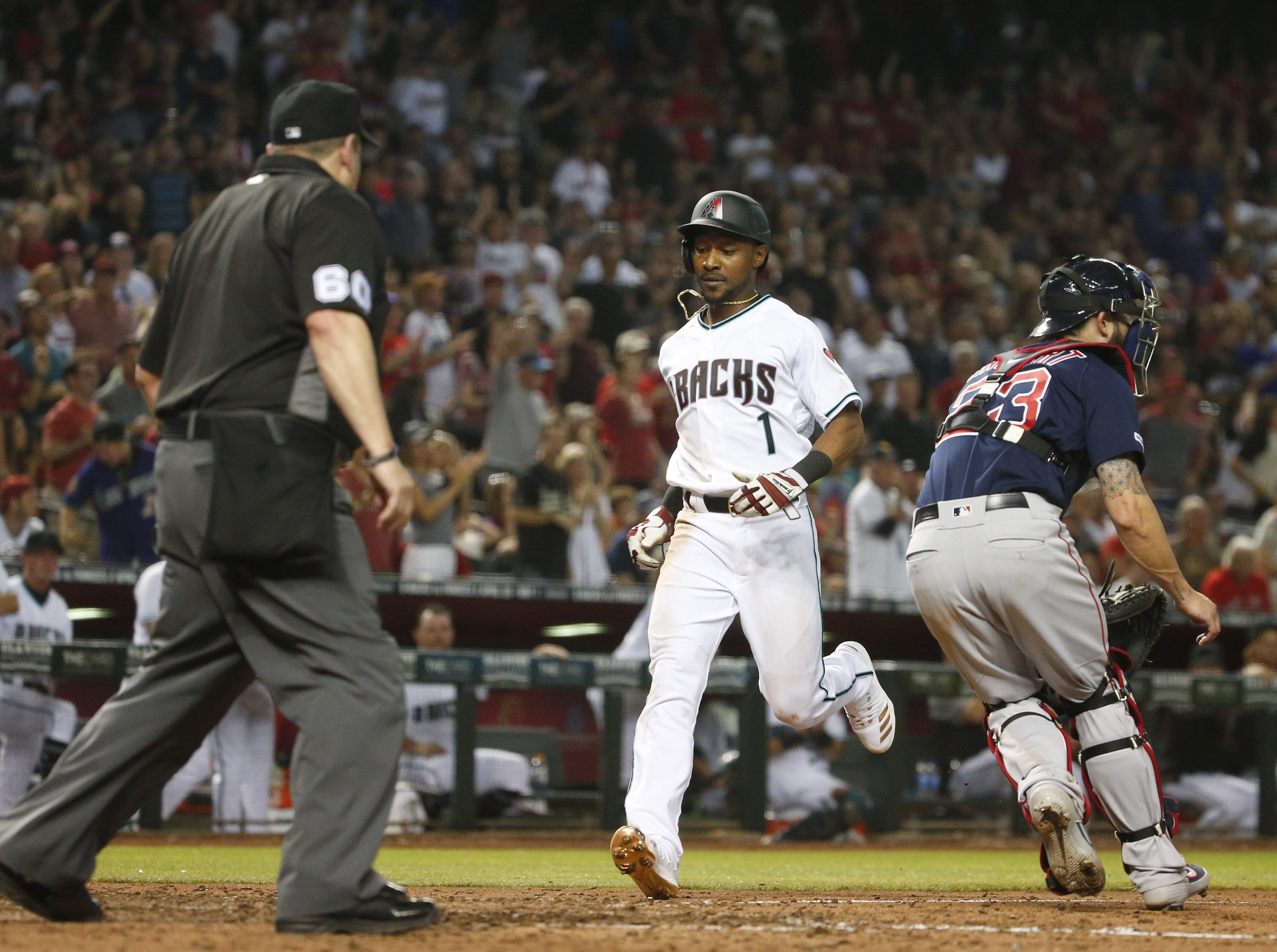 Arizona Diamondbacks center fielder Jarrod Dyson (1) scores a run during Opening Day against the Boston Red Sox at Chase Field in Phoenix on April 5.