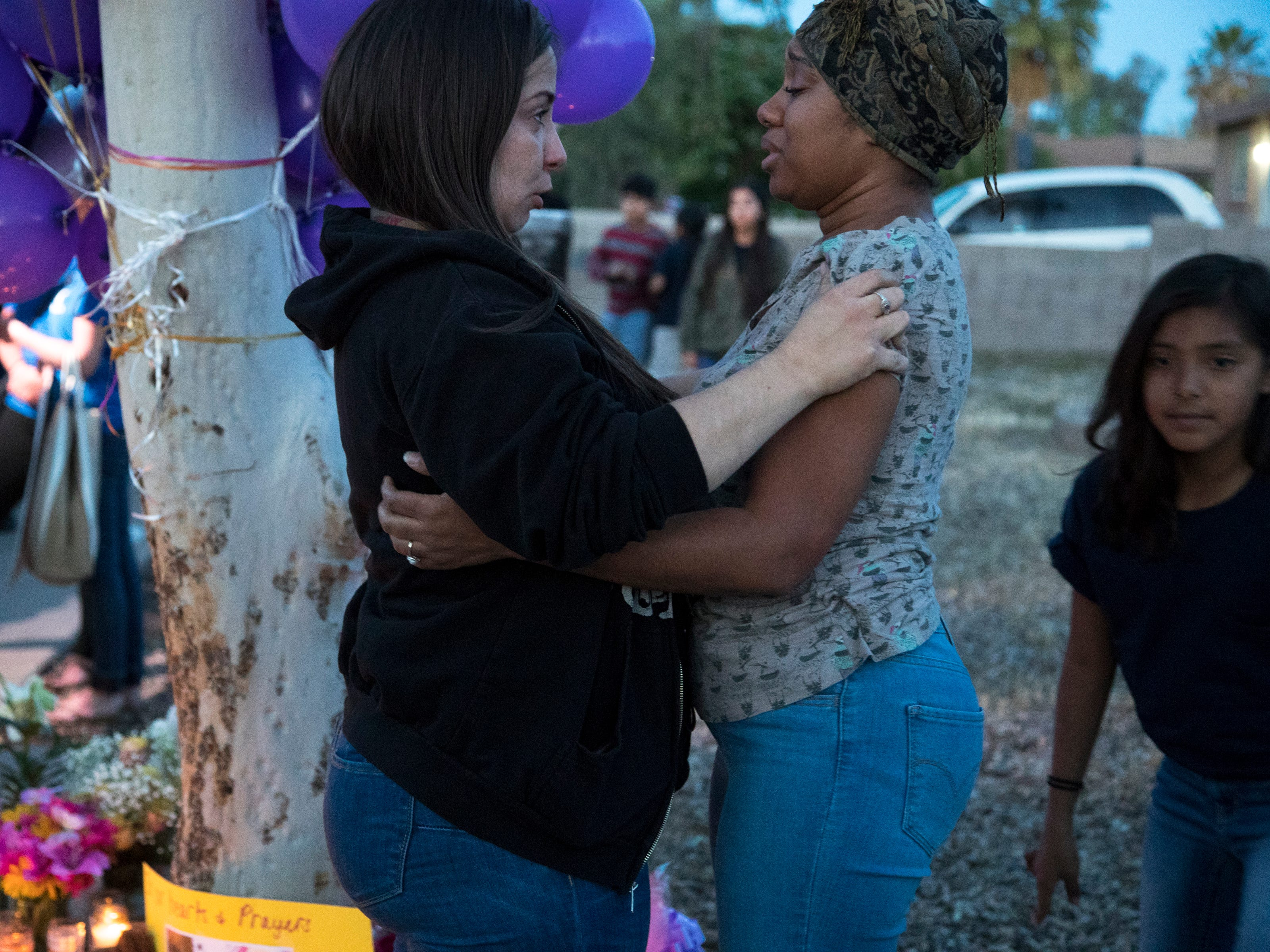 Taniesha Brown (right, Summer's mom) is comforted during a vigil for Summer Bell Brown on April 5, 2019.