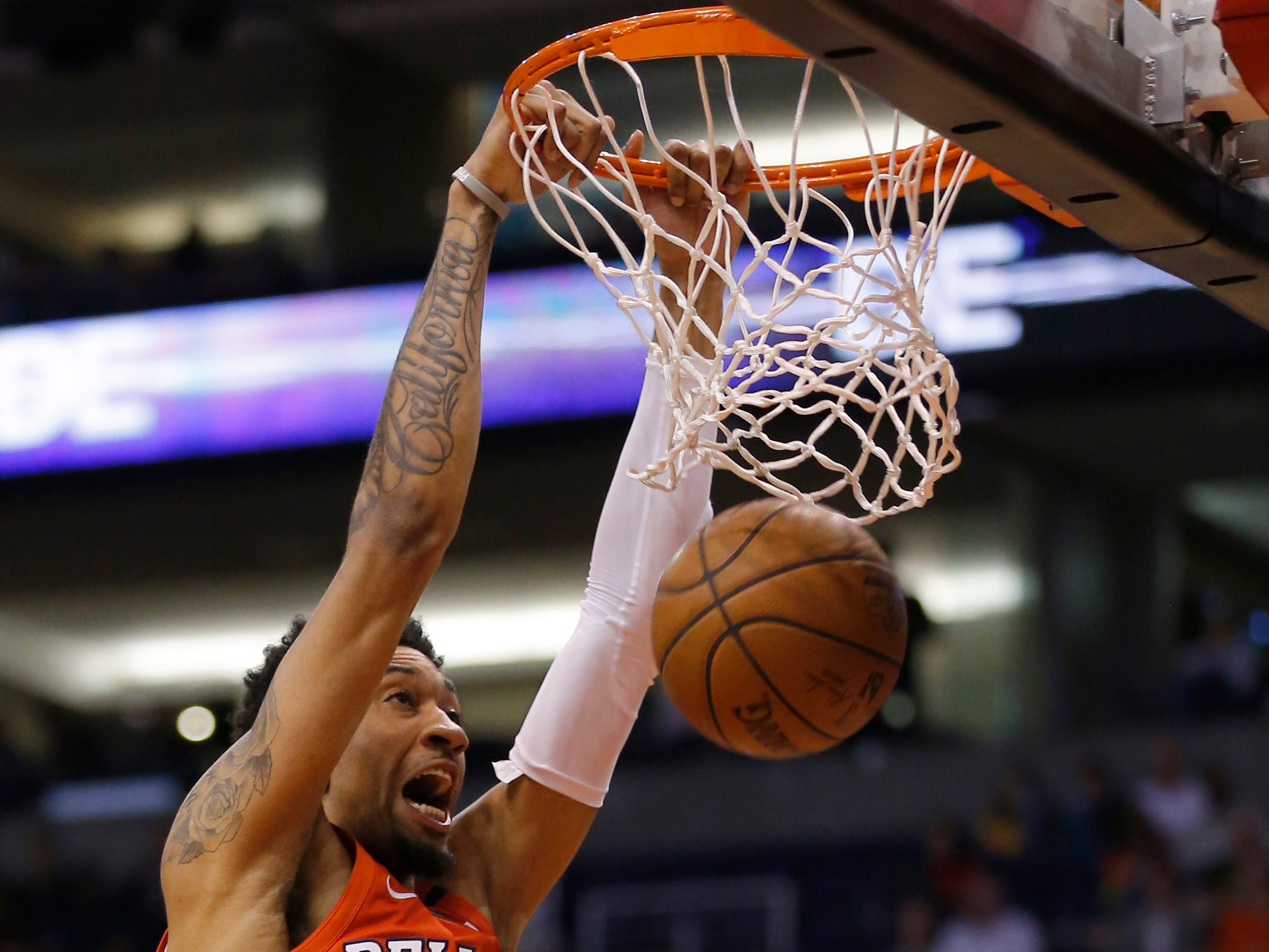 New Orleans Pelicans forward Christian Wood (35) dunks over Phoenix Suns forward Josh Jackson (20) during the first half of an NBA basketball game, Friday, April 5, 2019, in Phoenix. (AP Photo/Rick Scuteri)
