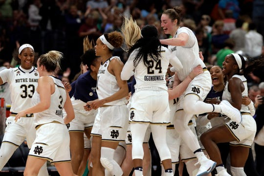 The Notre Dame team celebrates at the end of the team's 81-76 win over Connecticut during a Final Four semifinal of the NCAA women's college basketball tournament Friday, April 5, 2019, in Tampa, Fla.(AP Photo/Chris O'Meara)
