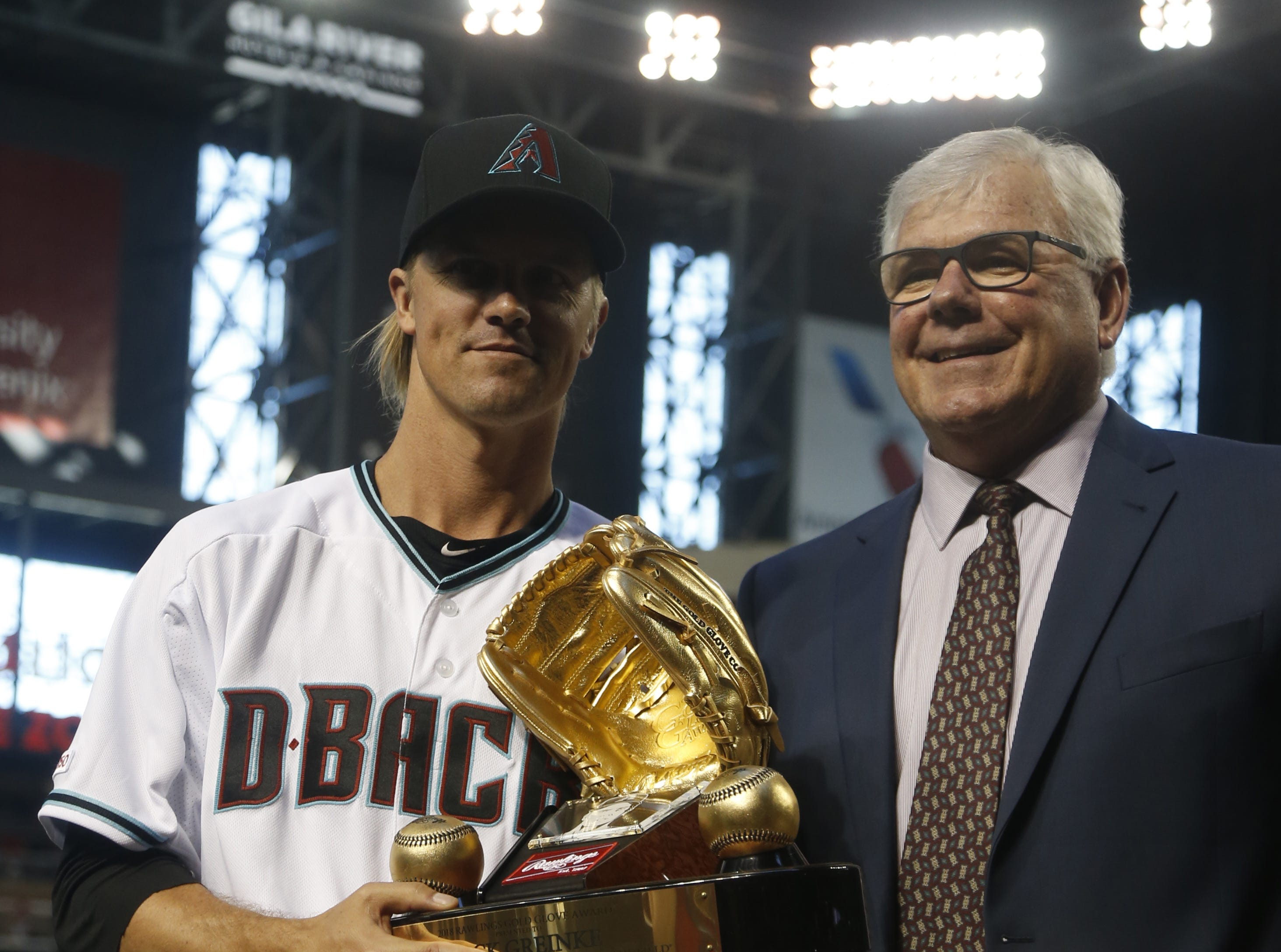 Diamondbacks' Zack Greinke accepts the Golden Glove Award from an MLB official before the Diamondbacks vs. Red Sox game at Chase Field on the Opening Day for the Diamondbacks in Phoenix, Ariz. on April 5, 2019.