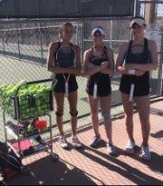 Desert Mountain girls tennis players (L to R) Savanna Kollack, McKenna Koenig and Josie Frazier stand next to a ball hopper on April 4, 2019.