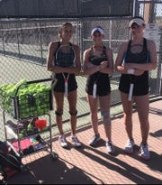 Desert Mountain girls tennis players (L to R) Savanna Kollack, McKenna Koenig and Josie Frazier stand next to a ball hopper on April 4, 2019.