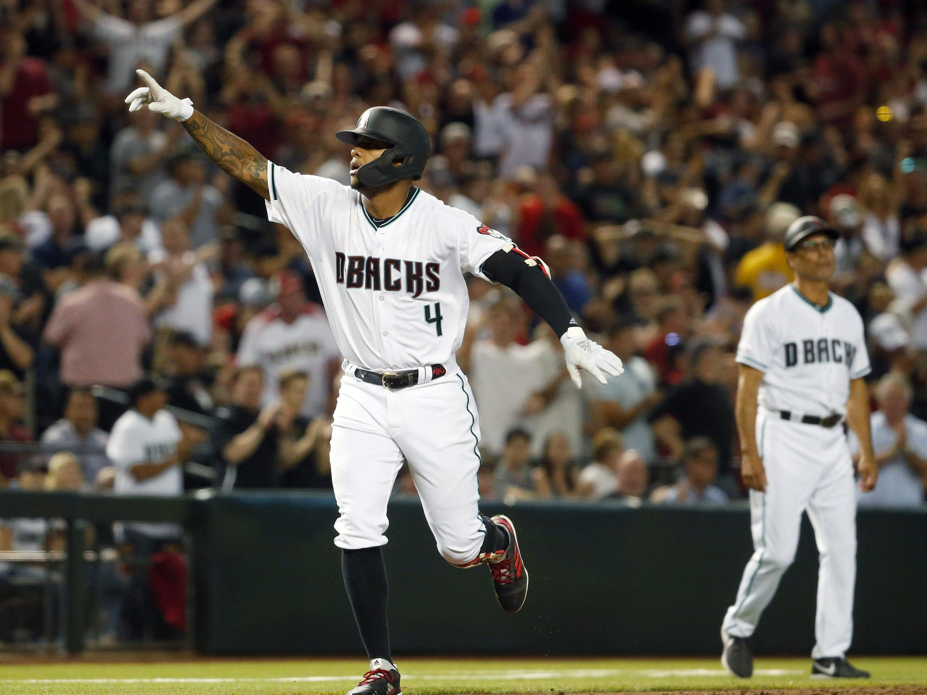 Arizona Diamondbacks shortstop Ketel Marte's (4) rounds third base after hitting a grand slam ball in the sixth inning of a Opening Day game  against Boston Red Sox at Chase Field in Phoenix on April 5.