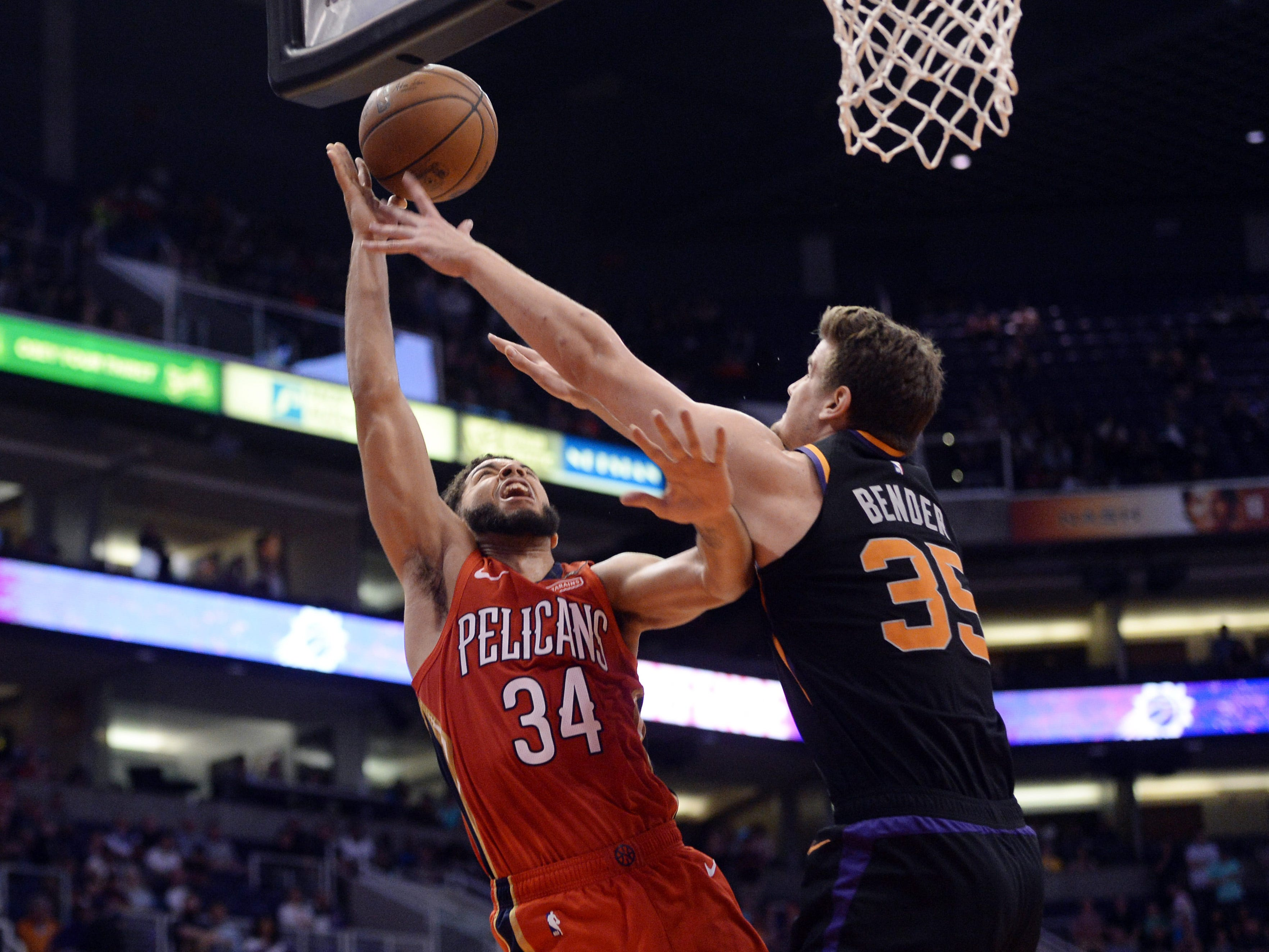 Apr 5, 2019; Phoenix, AZ, USA; Phoenix Suns forward Dragan Bender (35) blocks a shot attempt by New Orleans Pelicans guard Kenrich Williams (34) during the overtime session at Talking Stick Resort Arena. Mandatory Credit: Joe Camporeale-USA TODAY Sports