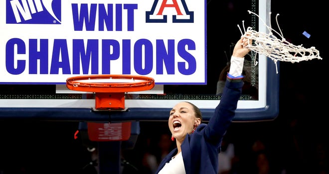 Arizona coach Adia Barnes waves the net after the team defeated Northwestern 56-42 during an NCAA college basketball game for the WNIT championship Saturday, April 6, 2019, in Tucson, Ariz.