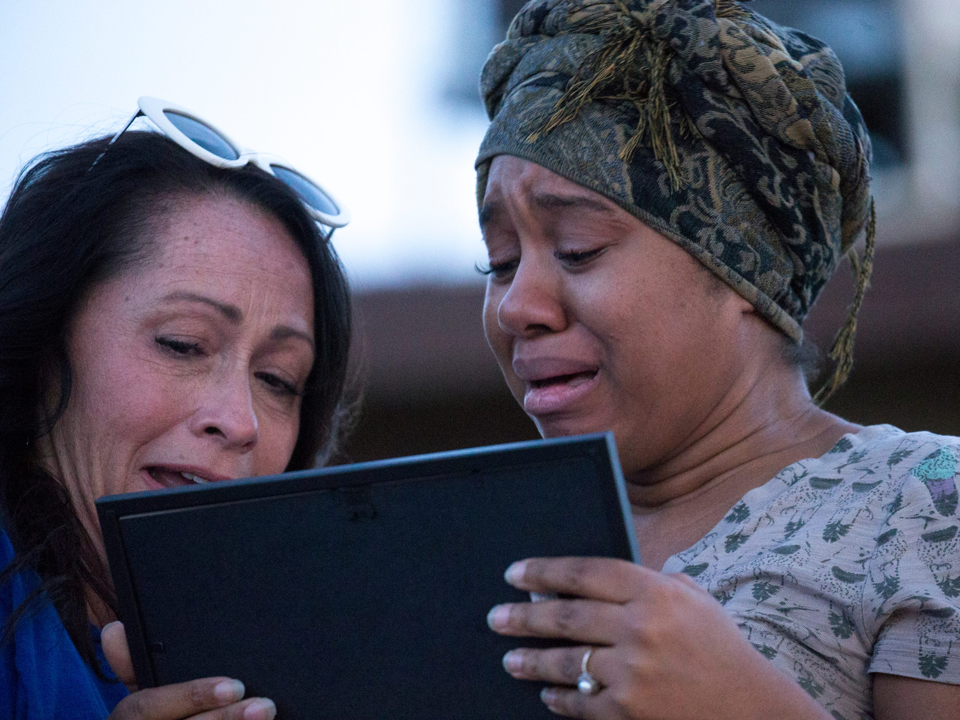Taniesha Brown (right, Summer's mom) is overcome with emotion after Rebecka Johnson (left, Summer's 5th grade teacher) gave her Summer's last art assignment during a vigil for Summer Bell Brown on April 5, 2019. Summer was shot in the driveway of her home and later died from her injuries in a suspected road-rage incident.