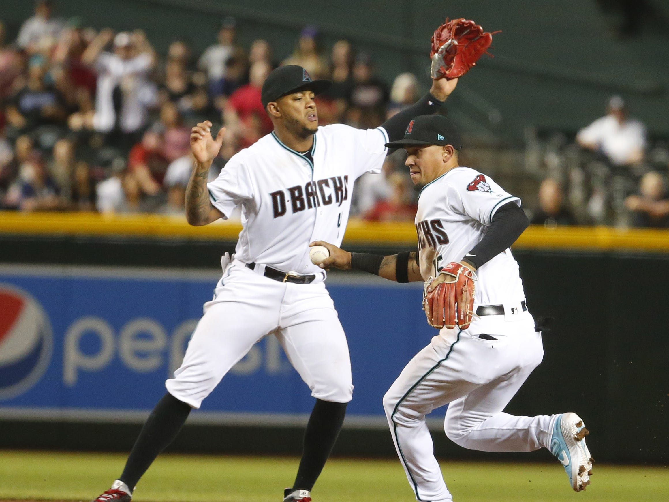 Arizona Diamondbacks Ildemaro Vargas throws to first to end the game against the Boston Red Sox at Chase Field in Phoenix on April 5.