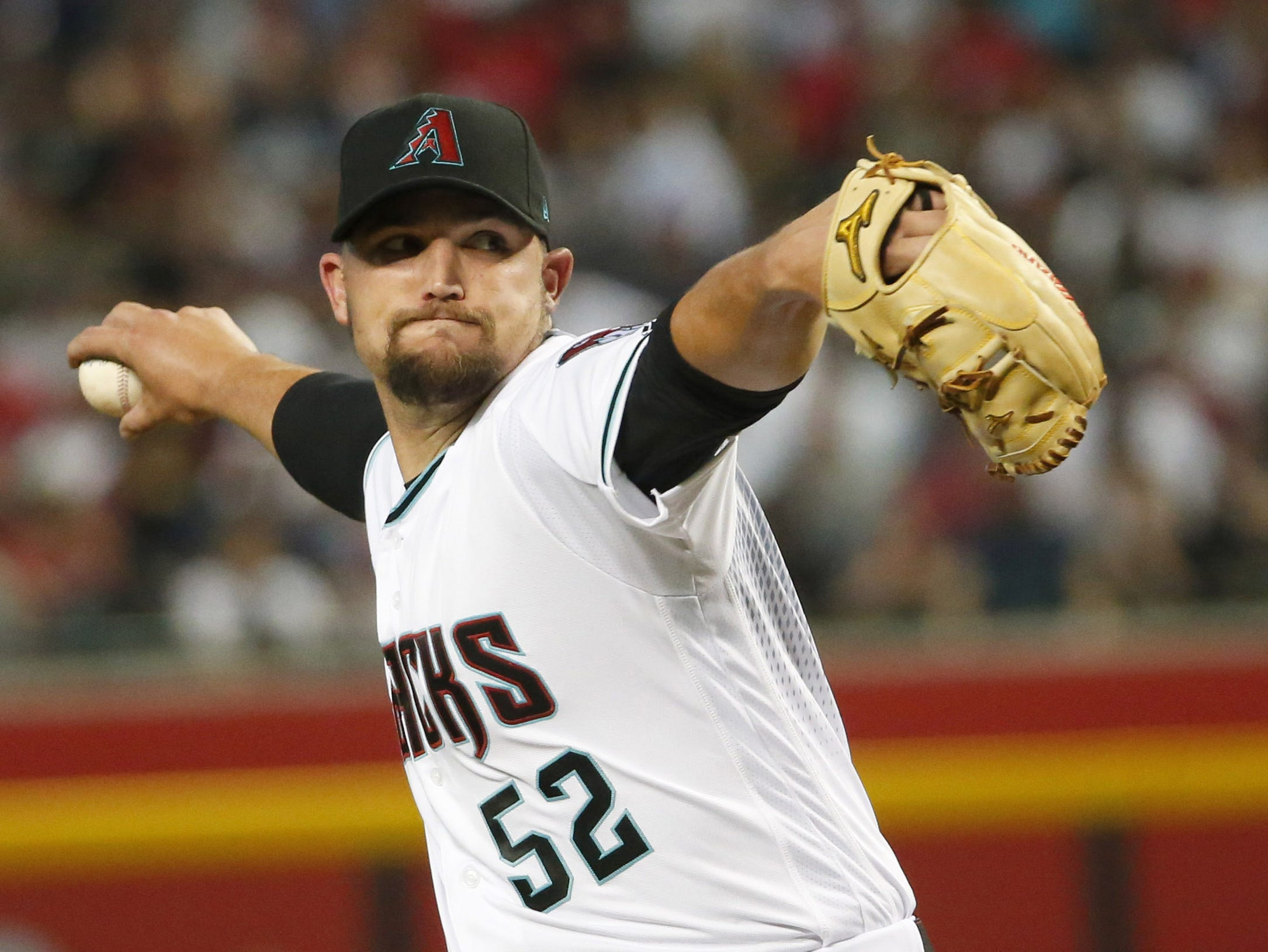 Arizona Diamondbacks starting pitcher Zack Godley (52) throws during Opening Day against the Boston Red Sox at Chase Field in Phoenix on April 5.