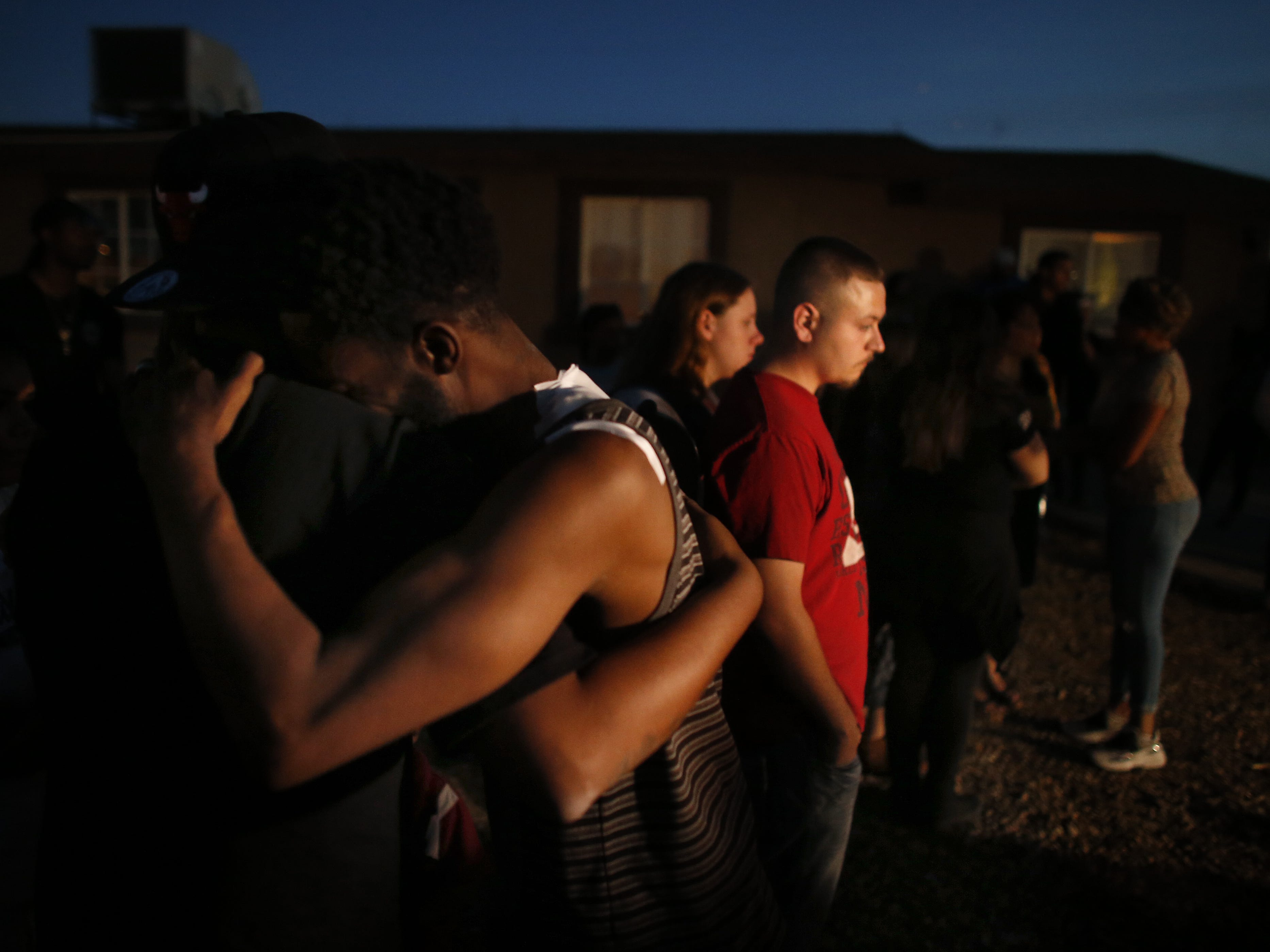 Summer's father Dharquintium Brown hugs people who came to support the family at a vigil for Summer Bell Brown on April 5, 2019, outside her home where she was shot and killed in Phoenix.