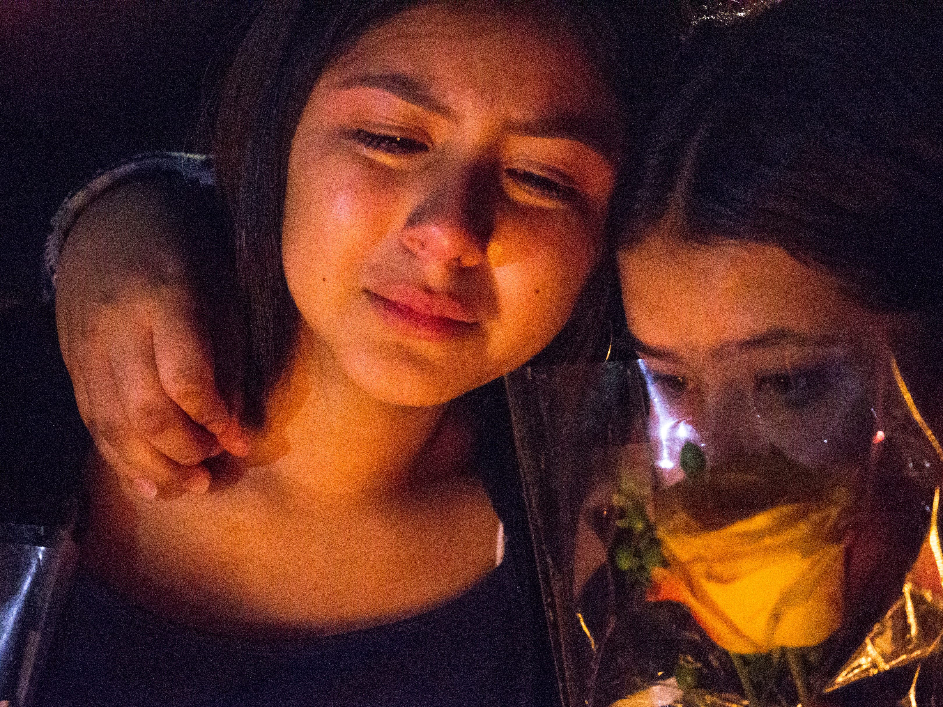 Friends grieve during a vigil for Summer Bell Brown on April 5, 2019.