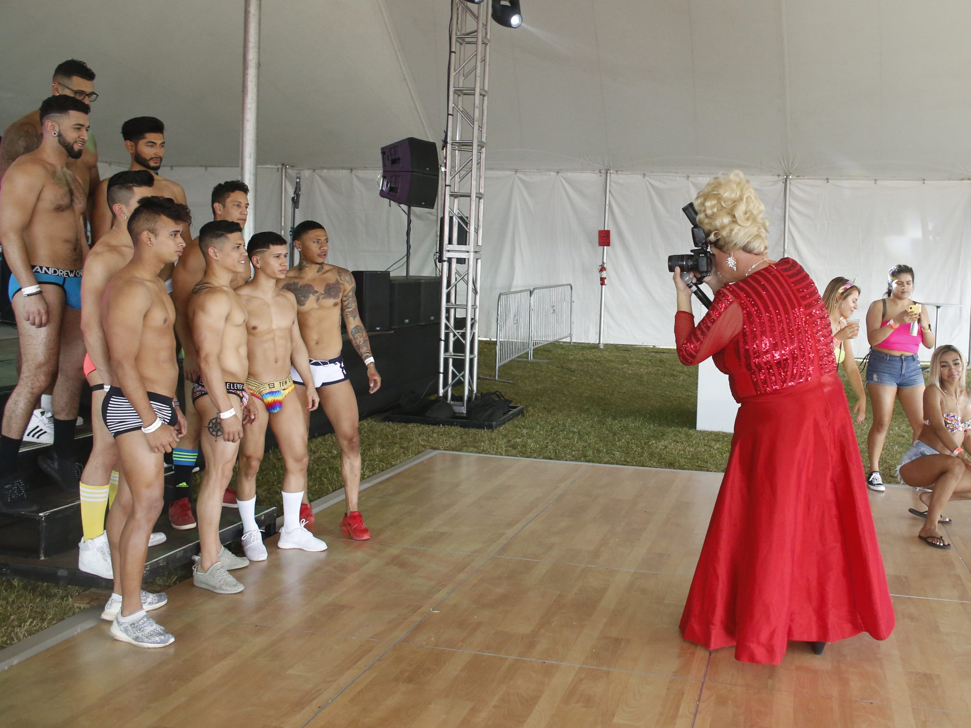 Models take to the dance floor for a picture during Phoenix Pride at Steele Indian School Park on April 6, 2019.