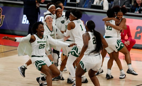 Baylor players celebrate their 72-67 win over Oregon during a Final Four semifinal of the NCAA women's college basketball tournament Friday, April 5, 2019, in Tampa, Fla. (AP Photo/Mark LoMoglio)