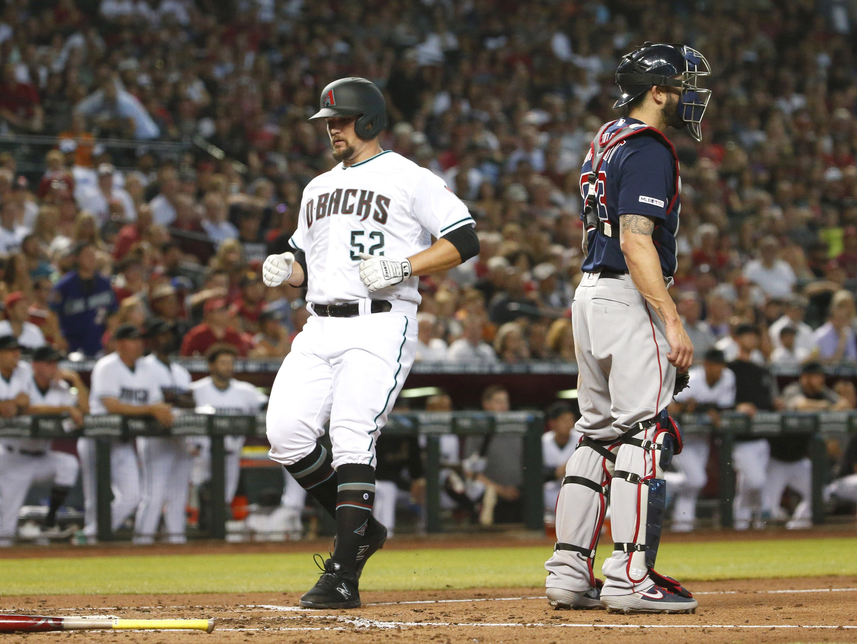 Arizona Diamondbacks starting pitcher Zack Godley (52) scores a run during the fourth inning of Opening Day against the Boston Red Sox at Chase Field in Phoenix on April 5.