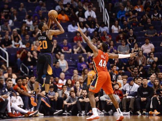 Apr 5, 2019; Phoenix, AZ, USA; Phoenix Suns forward Josh Jackson (20) shoots over New Orleans Pelicans forward Solomon Hill (44) during the overtime session at Talking Stick Resort Arena. Mandatory Credit: Joe Camporeale-USA TODAY Sports