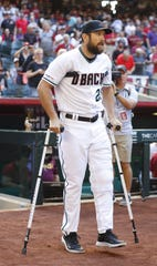 Steven Souza Jr. uses crutches to make his way out of the dugout for pregame introductions on Friday.