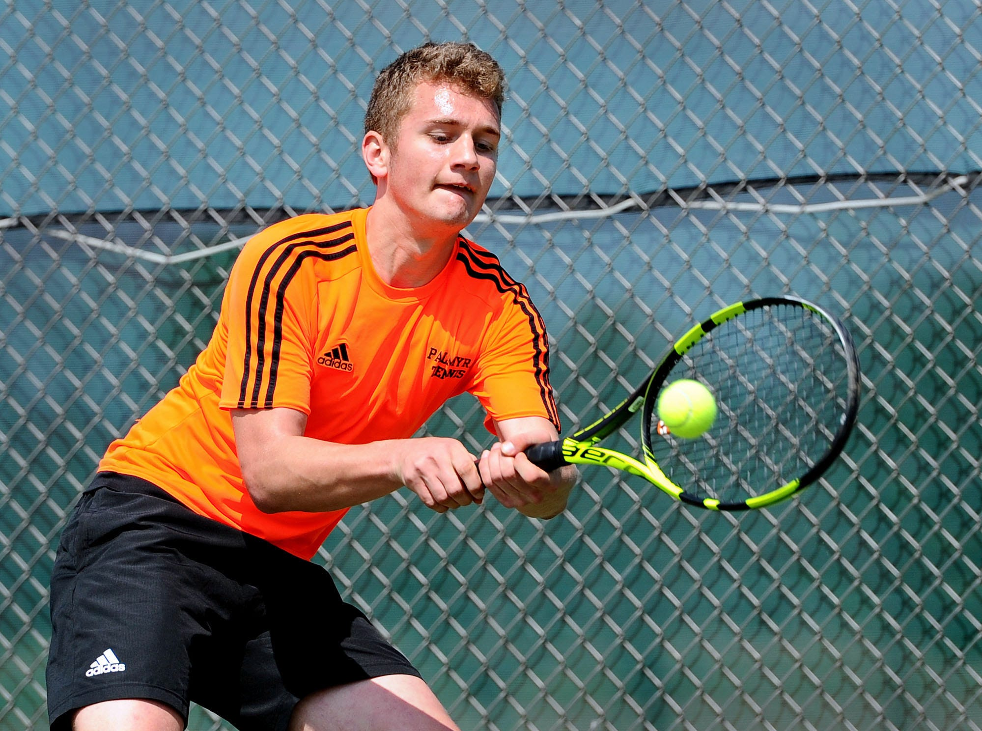 Palmyra's Ben Clary returns a backhand during his match against Cedar Crest's Jack Muraika in the finals of the Lebanon County boys tennis tournament Saturday April 6,2019 at Cedar Crest High School.