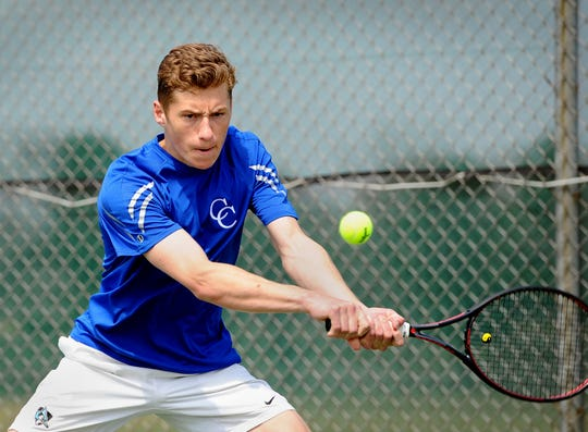 Jack Muraika of Cedar Crest hits a backhand during his match against Palmyra's Ben Clary in the finals of the Lebanon County boys tennis tournament Saturday April 6,2019 at Cedar Crest High School.