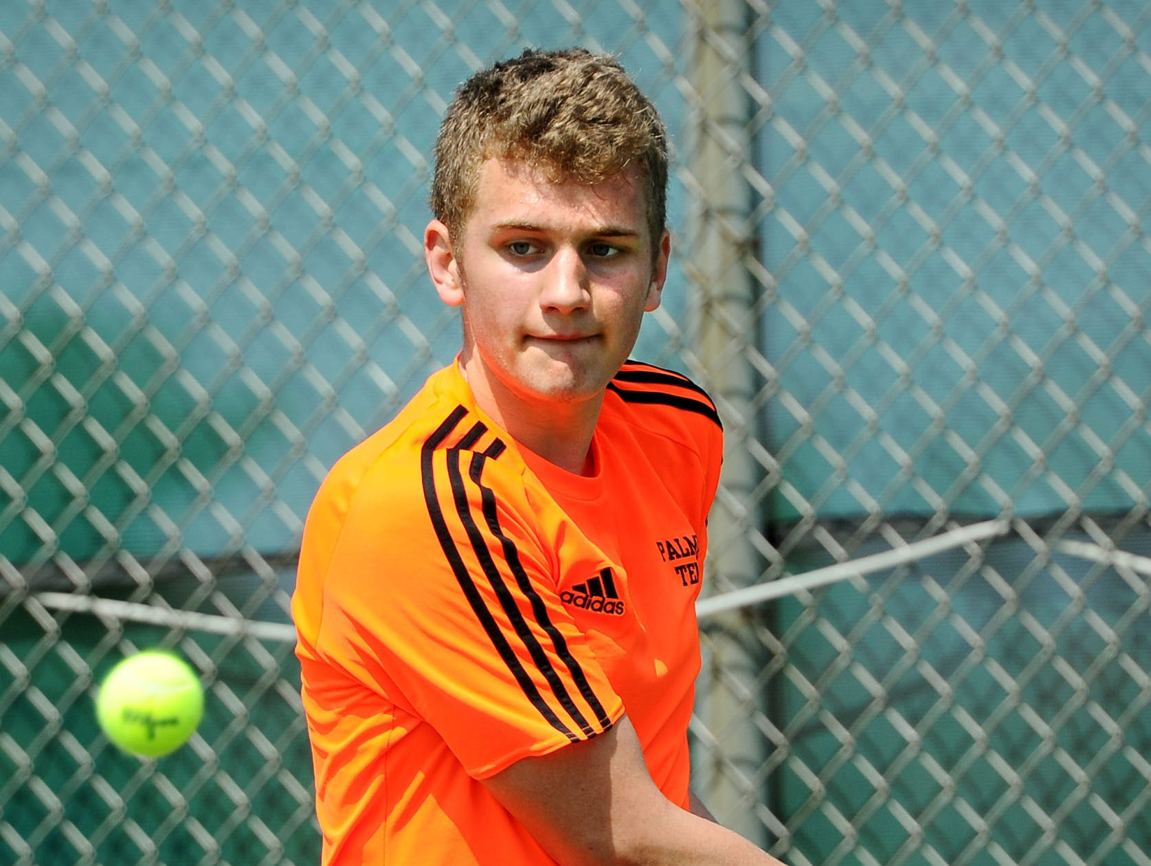 Palmyra's Ben Clary sets up for a backhand  during his match against Cedar Crest's Jack Muraika in the finals of the Lebanon County boys tennis tournament Saturday April 6,2019 at Cedar Crest High School.