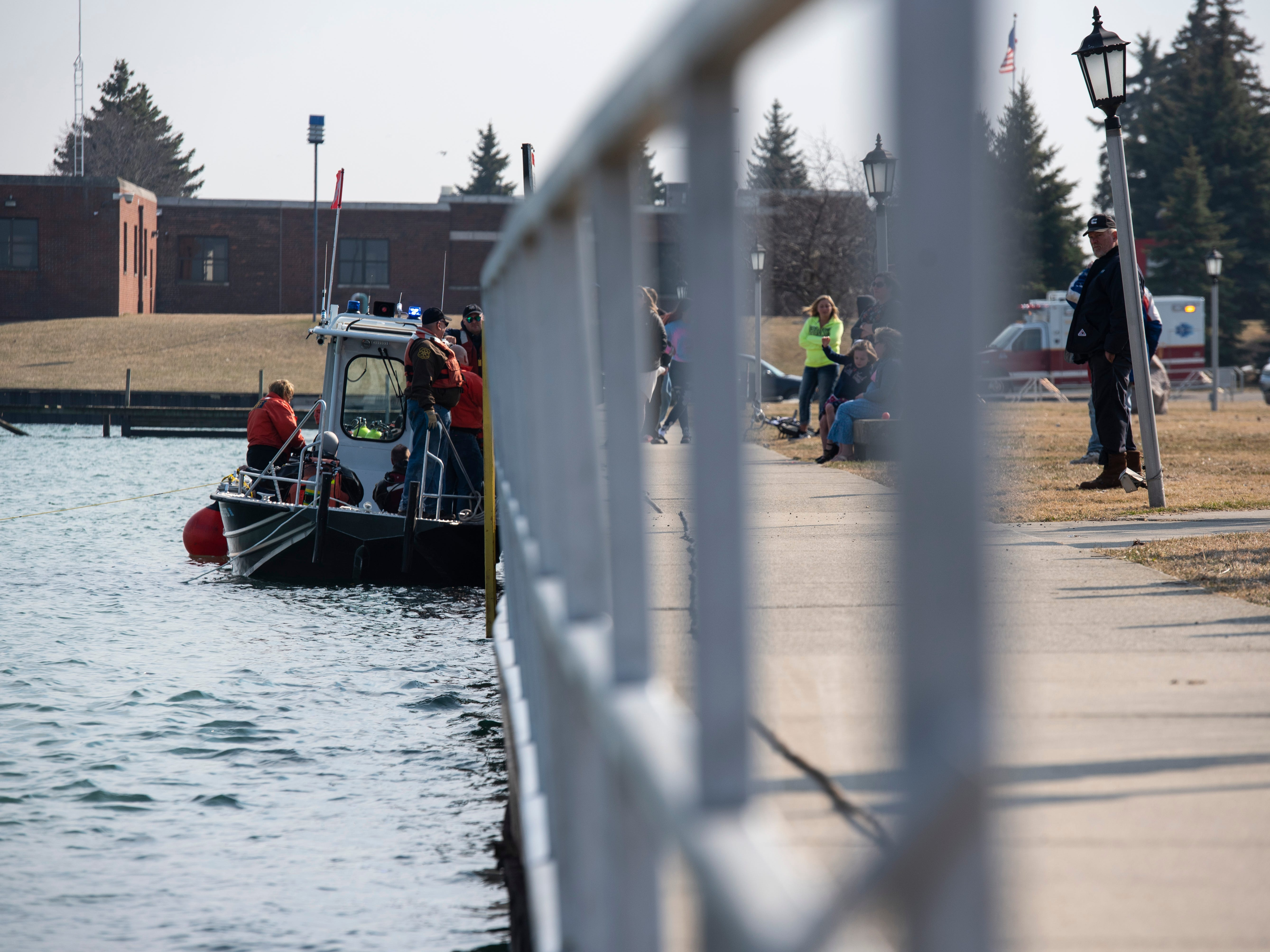 Crews work to remove a car from the St. Clair River near Junction Buoy in Marysville Saturday, April 6, 2019. The driver went to adjust the parking of the vehicle, and it rolled into the river. The vehicle floated down the river a ways before it and the driver went under. The driver later died.