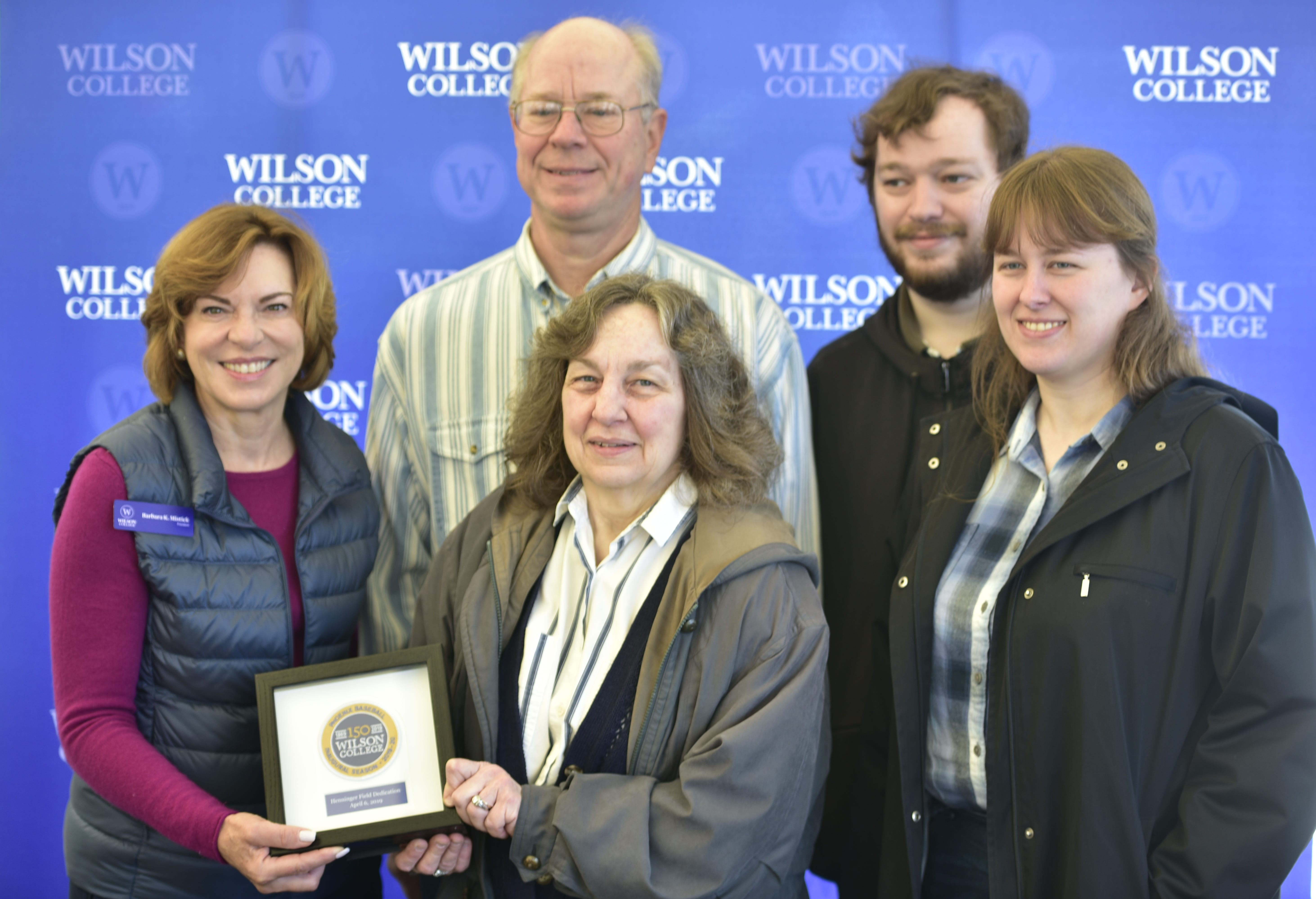 Wilson president Dr. Barbara K. Mistick poses with the Henninger family following a ceremony dedicating Henninger Field to the Wilson baseball program.