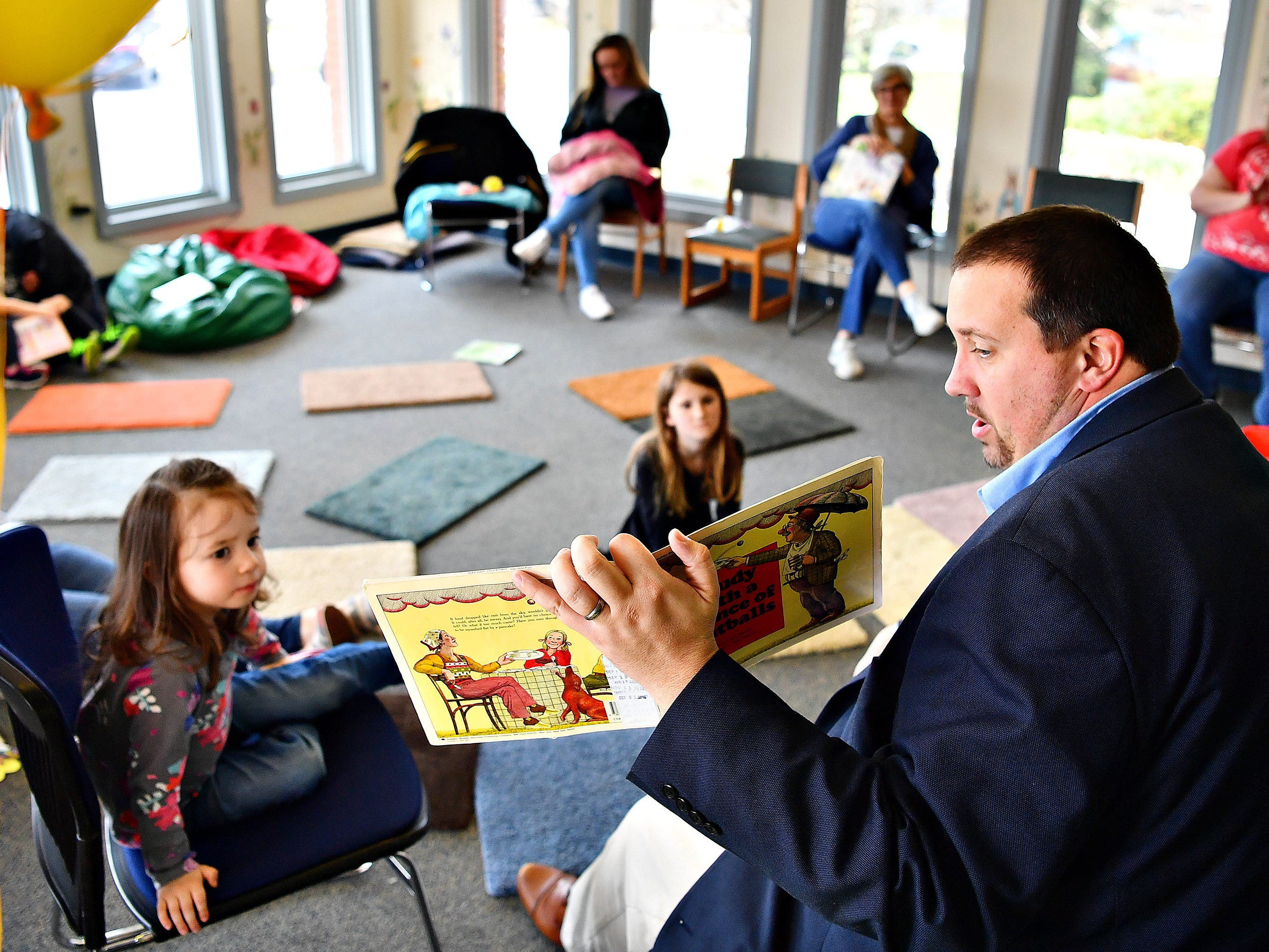 "Pennsylvania Rep. Seth Grove reads, ""Cloudy With a Chance of Meatballs"" written by Judi Barrett, during Glatfelter Memorial Library's Annual Read-a-thon event in Spring Grove, Saturday, April 6, 2019. Dawn J. Sagert photo"